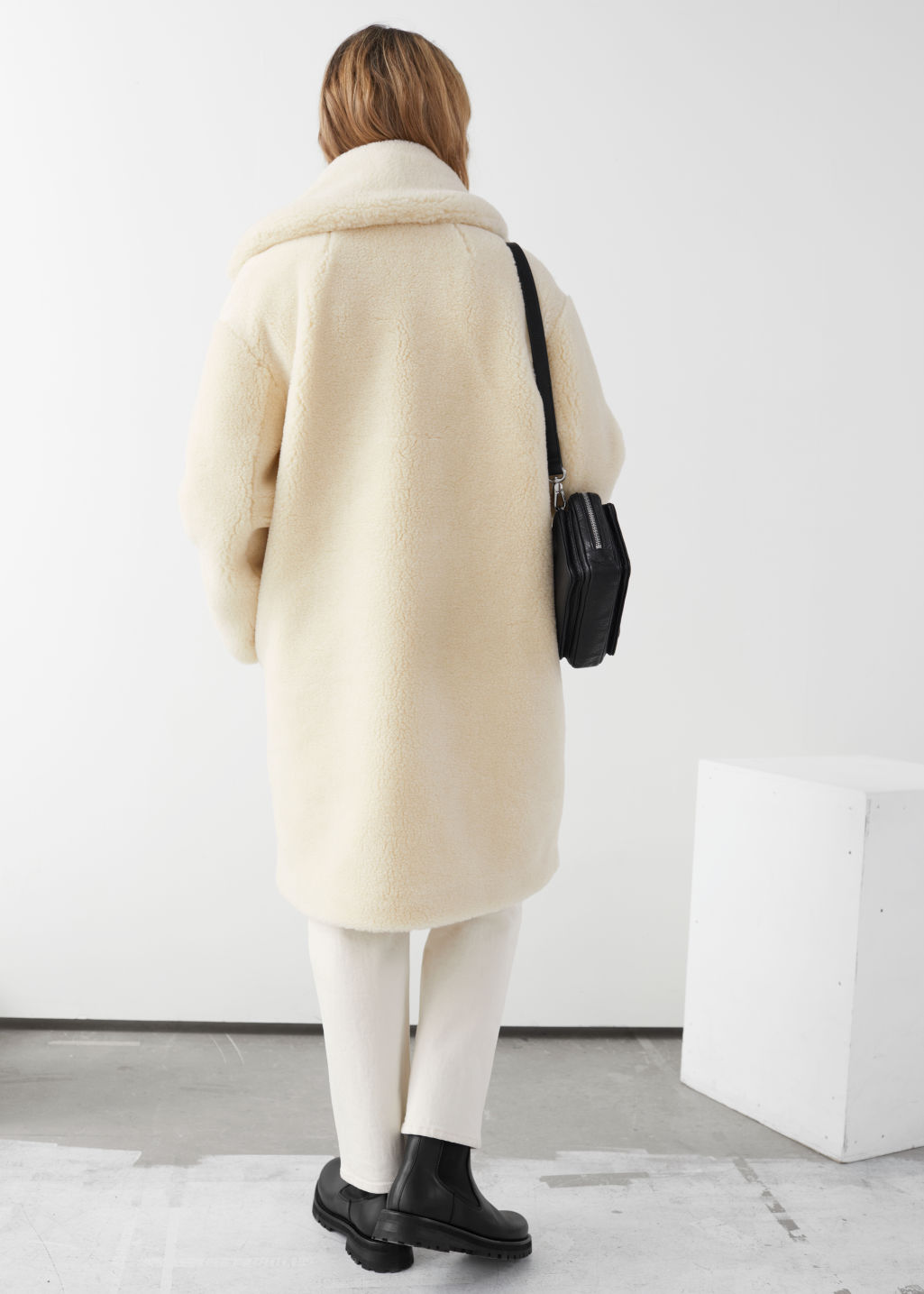Model back image of Stories faux shearling coat in yellow