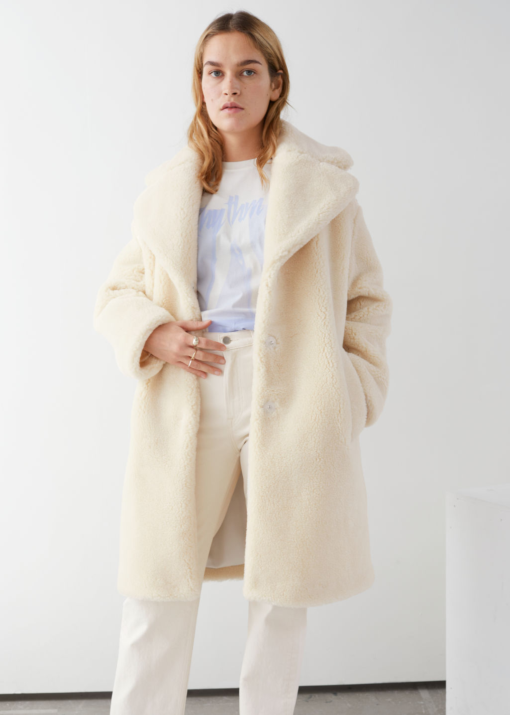 Model front image of Stories faux shearling coat in yellow