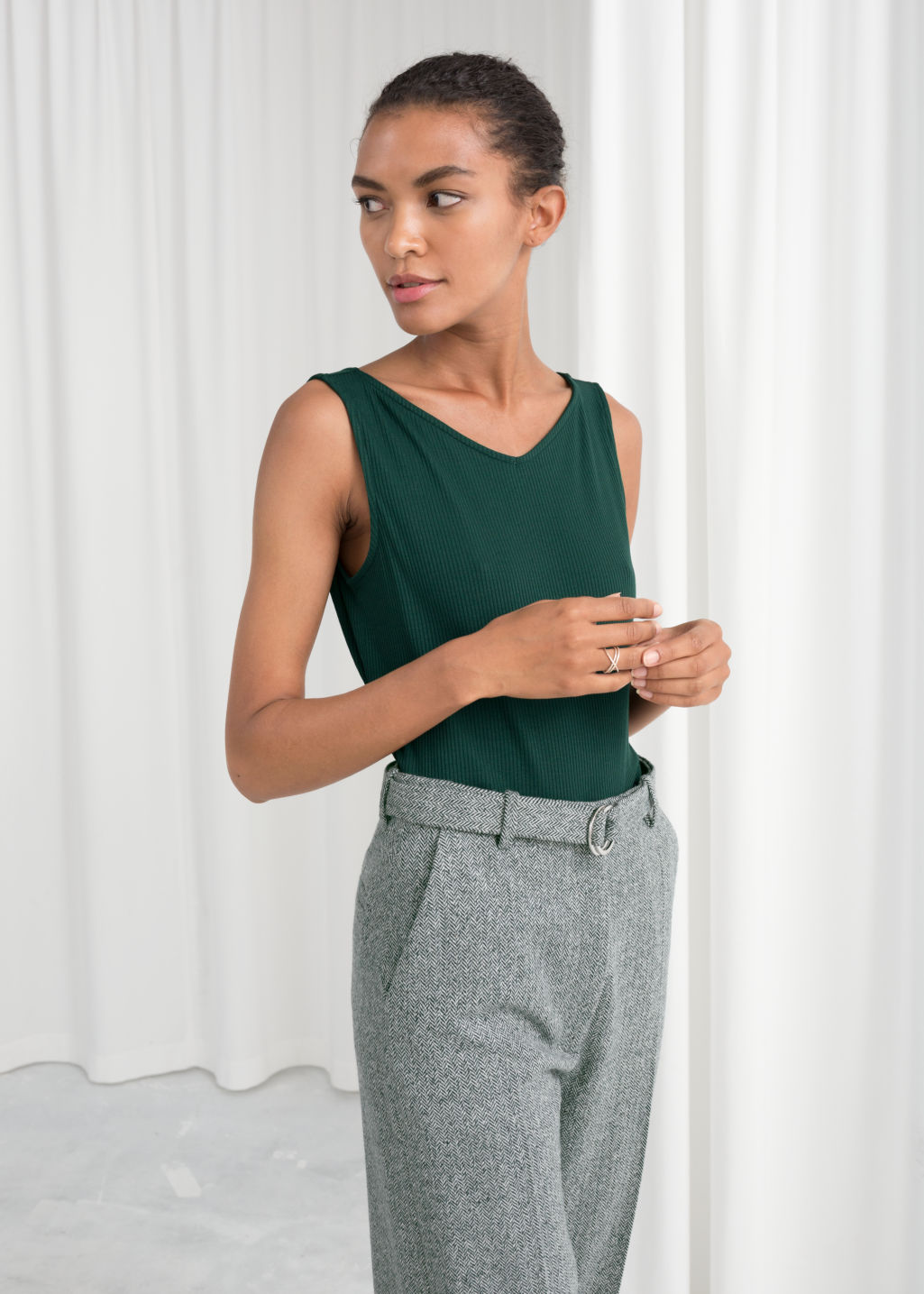 Model front image of Stories basic v-neck tank top in green