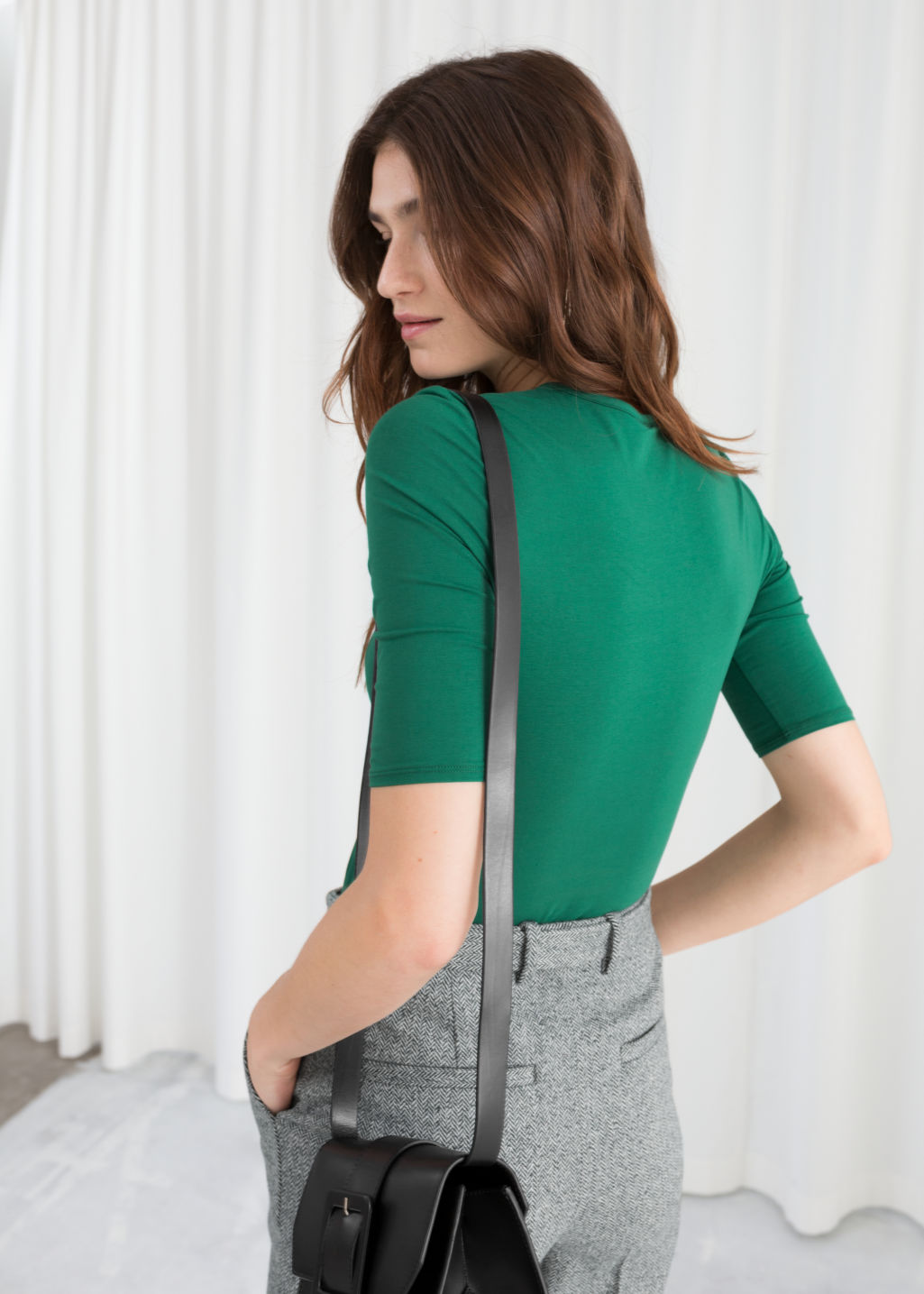 Model back image of Stories fitted stretch cotton tee in green