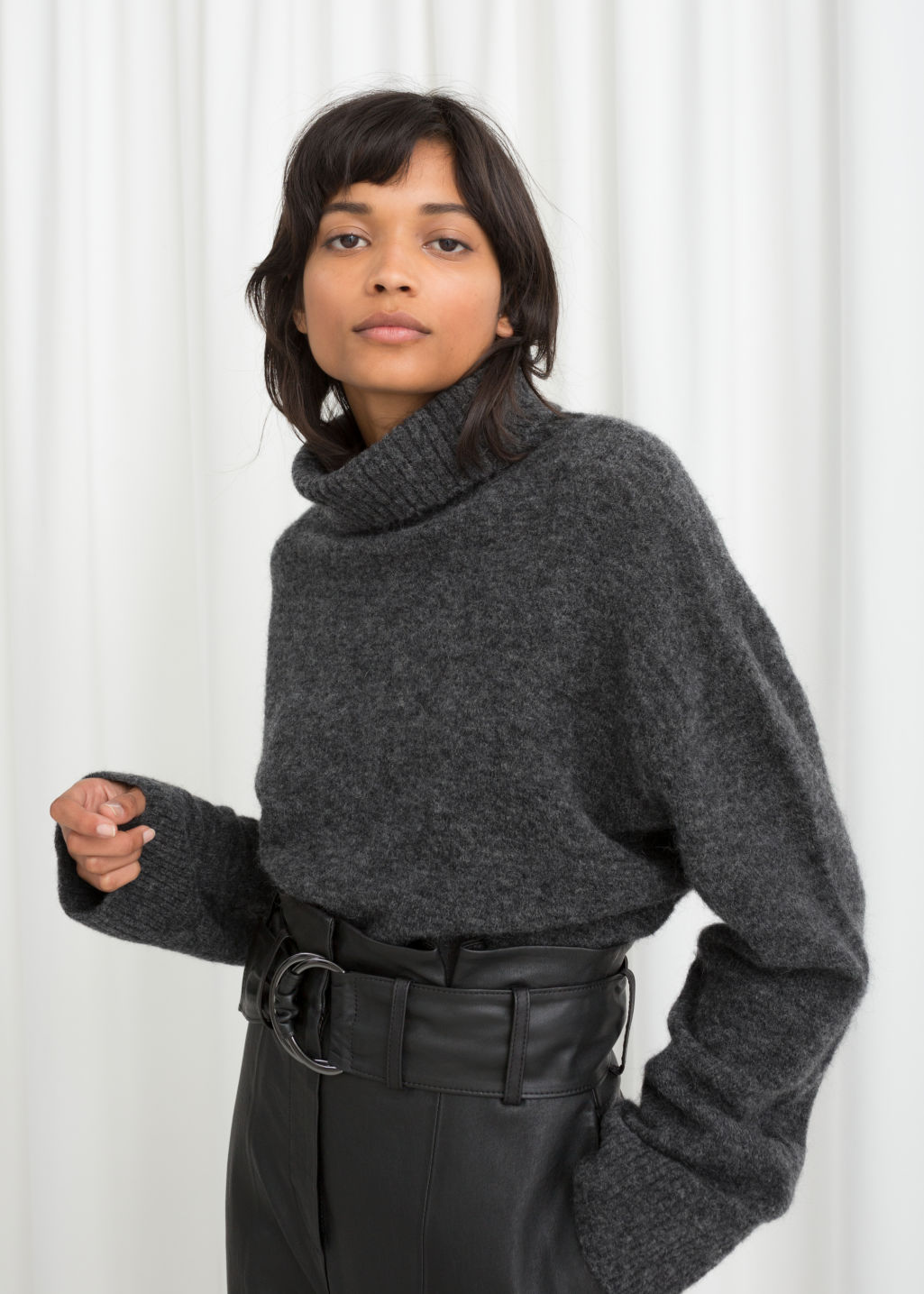Model front image of Stories wool blend turtleneck sweater in grey