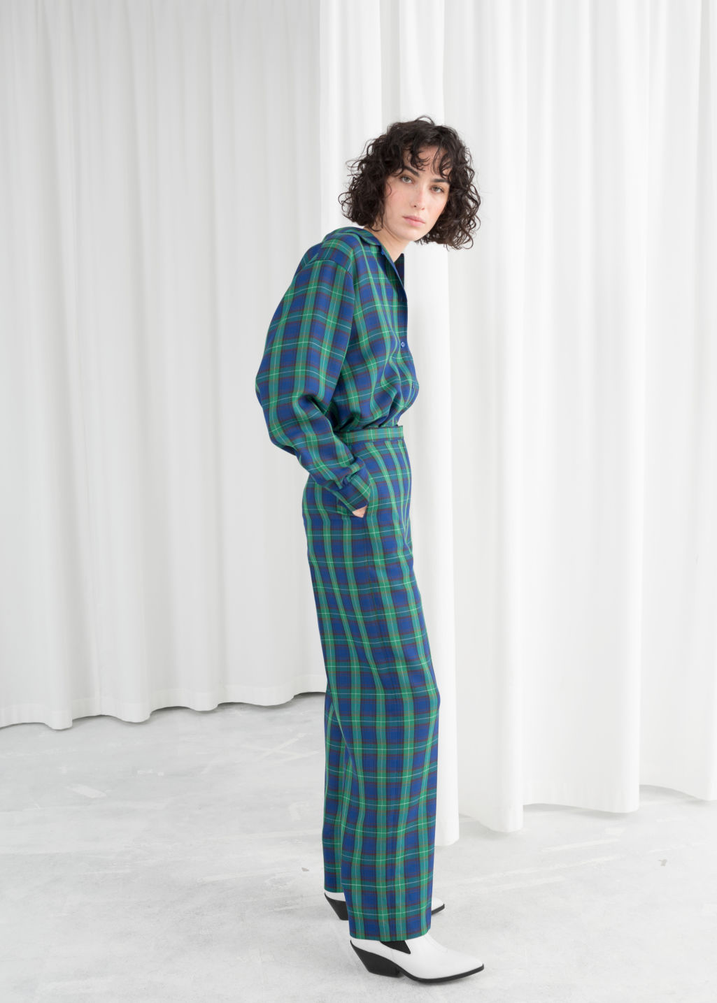 Model front image of Stories wool blend plaid trousers in green