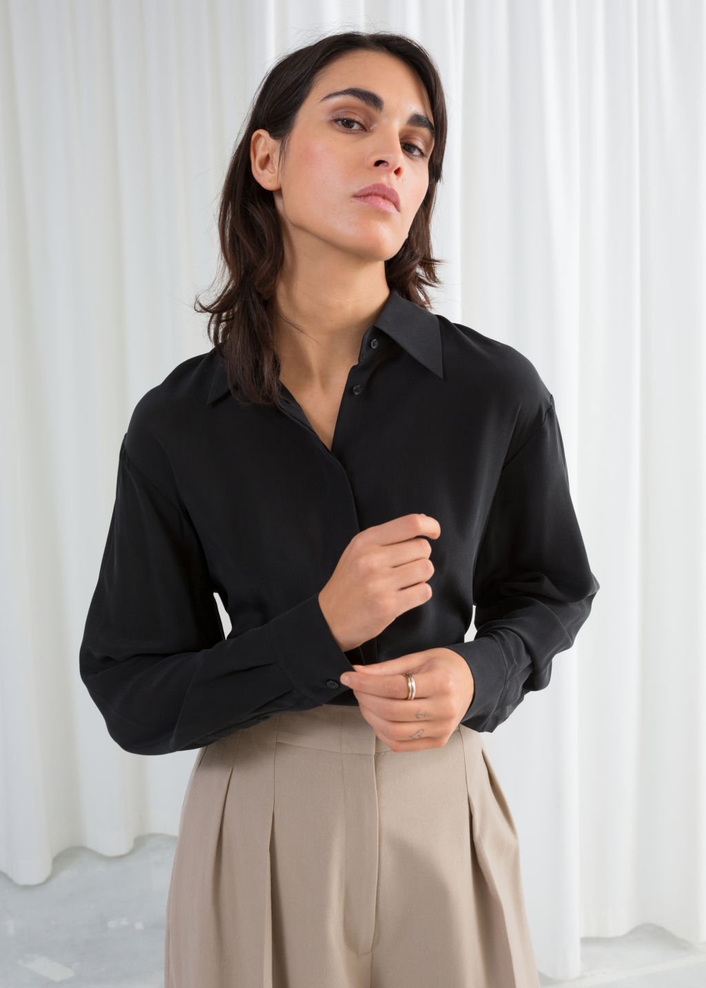 Model front image of Stories pointed collar silk shirt in black