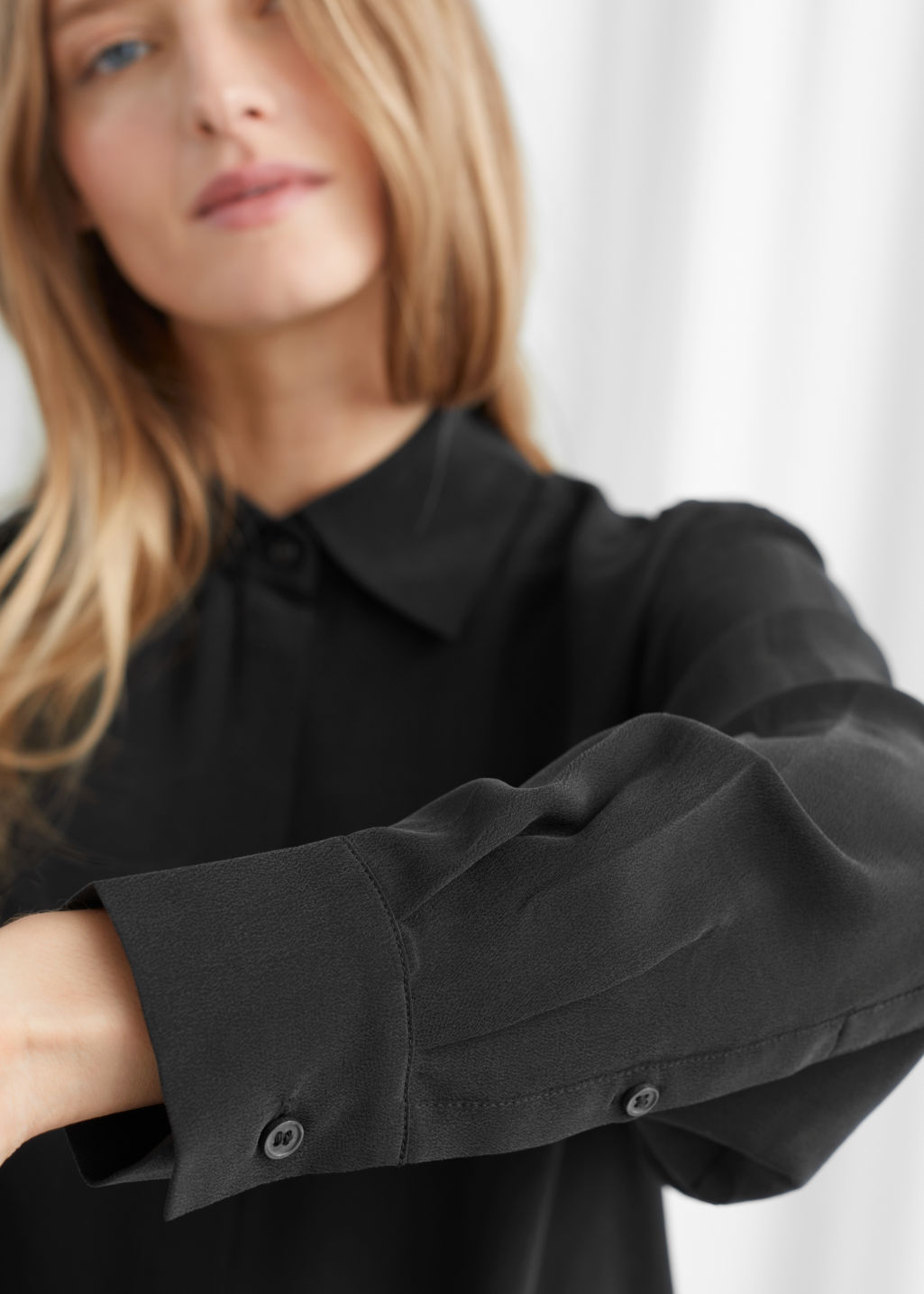 Model side image of Stories pointed collar silk shirt in black