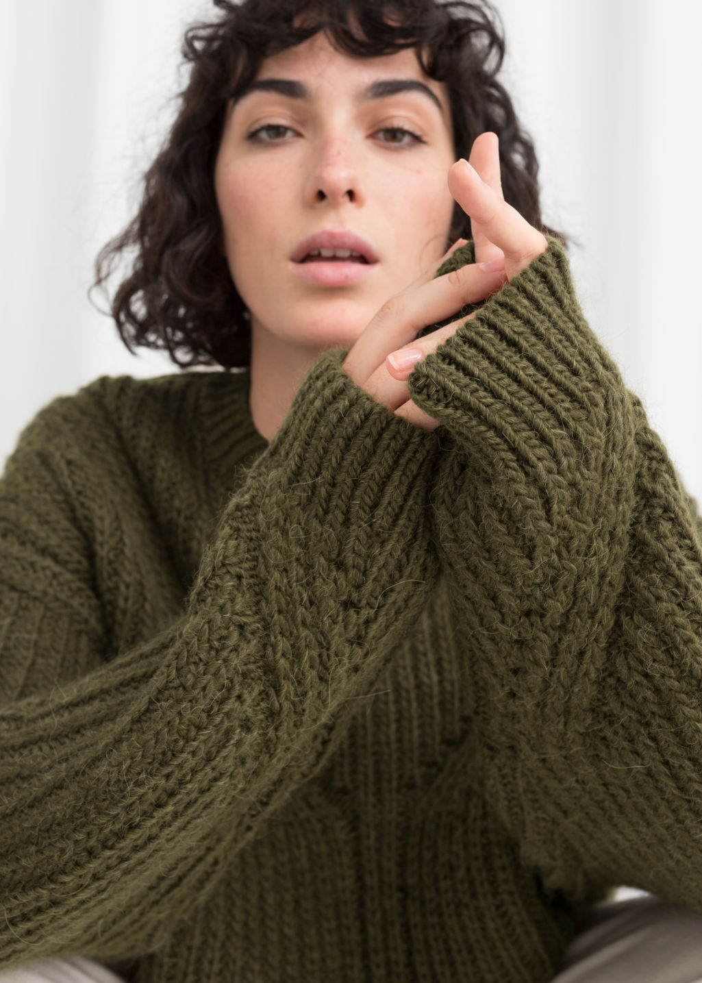 Model front image of Stories oversized curved knit sweater in green