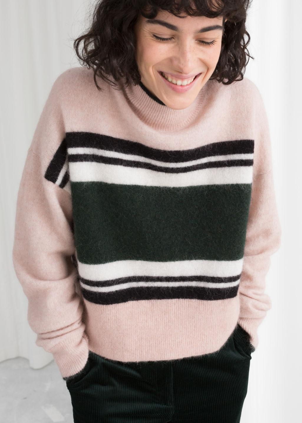 Model front image of Stories striped mock neck sweater in beige