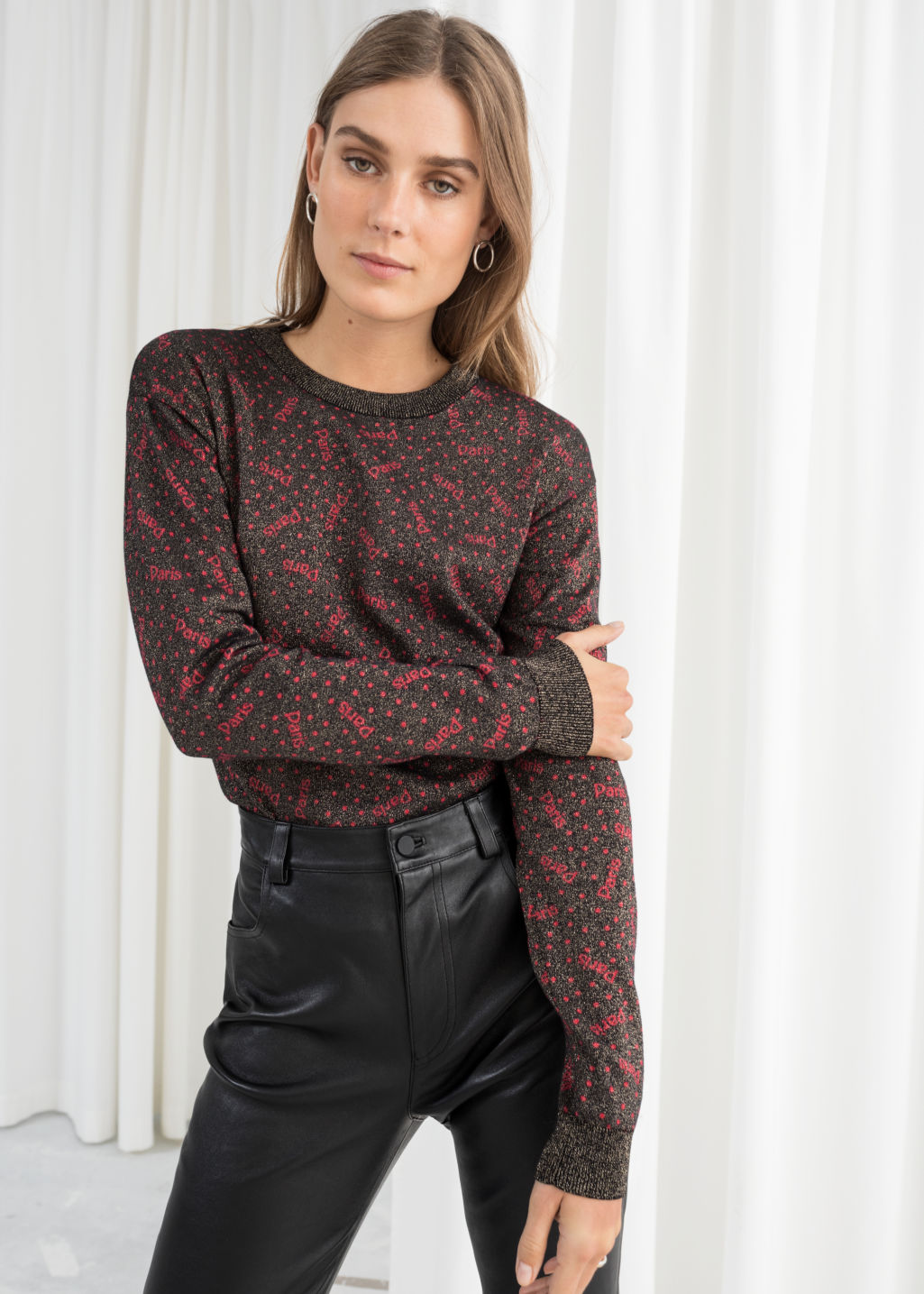 Model front image of Stories glitter paris pullover in black