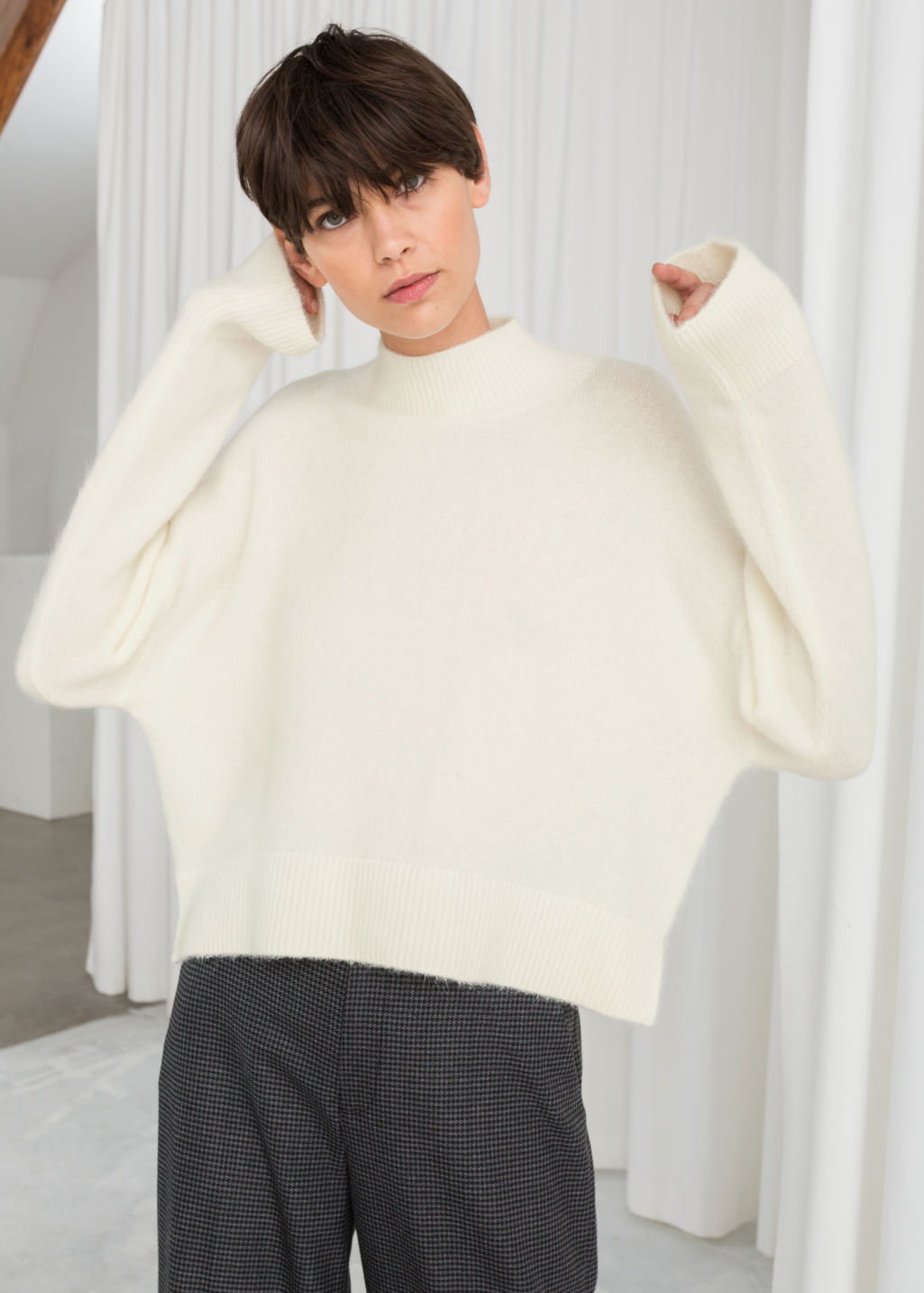 Model front image of Stories wool blend cropped turtleneck in white