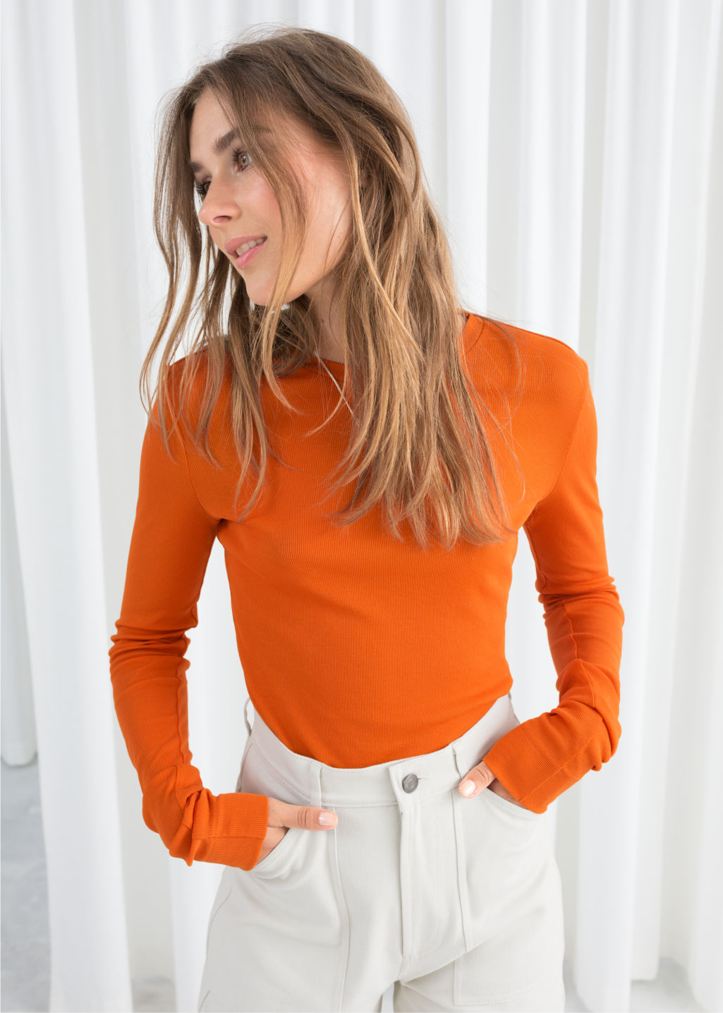 Model front image of Stories fitted cotton blend top in orange