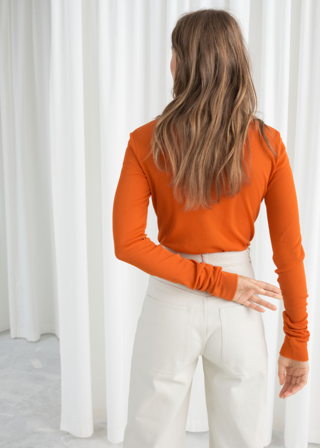 Model back image of Stories fitted cotton blend top in orange