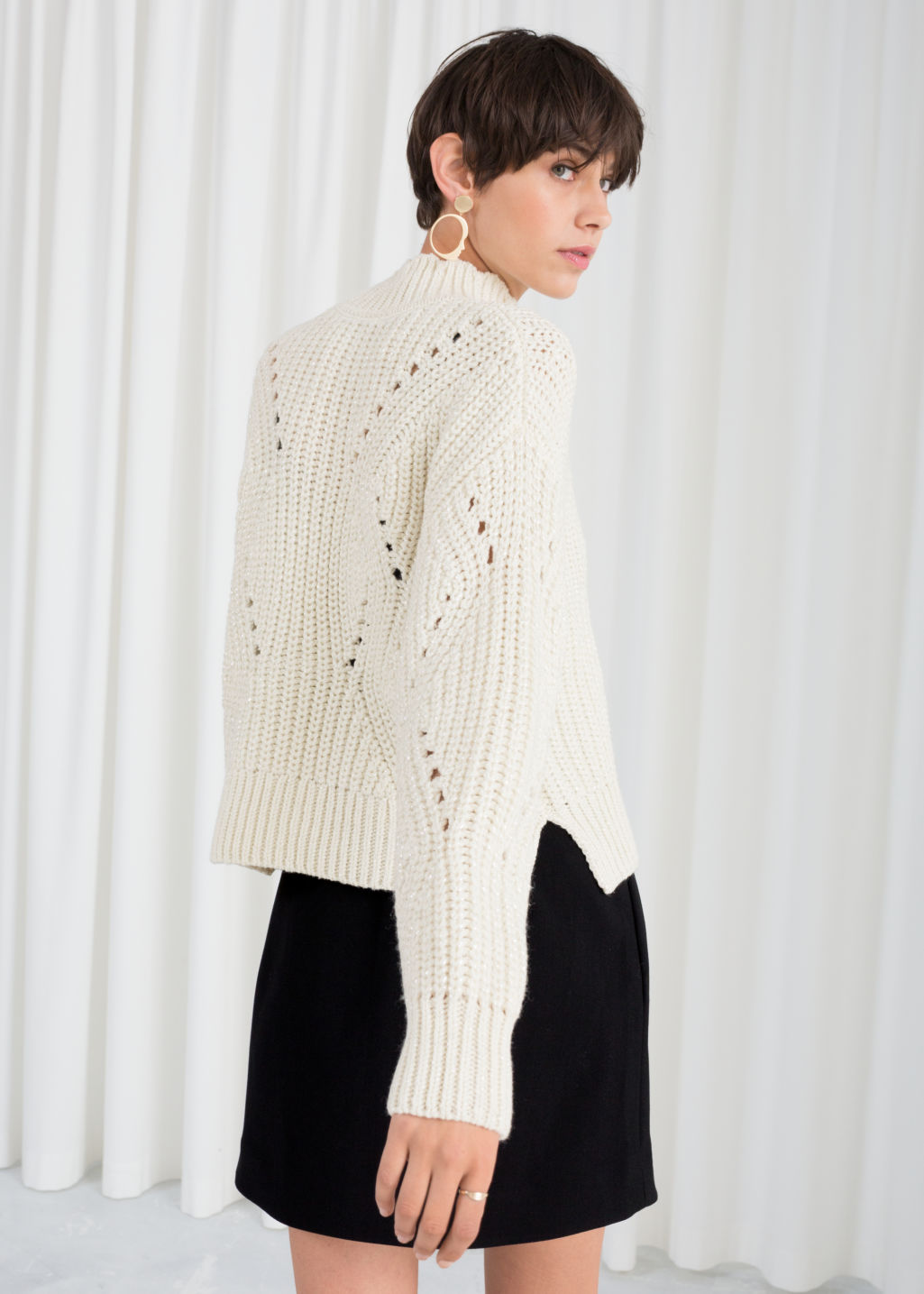 Model back image of Stories mock neck cable knit sweater in white