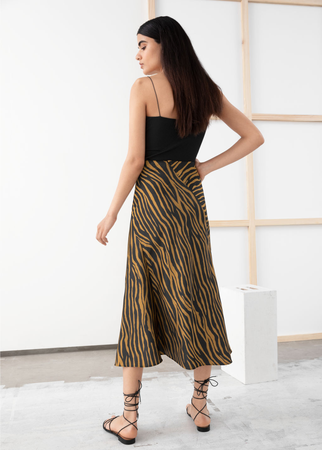 Model back image of Stories satin midi skirt in yellow