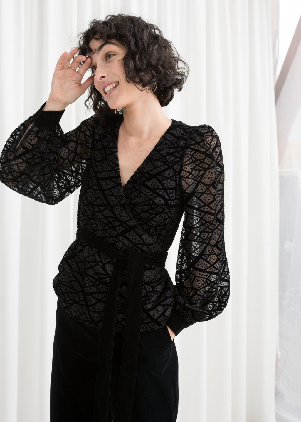 Model front image of Stories velvet mesh wrap top in black