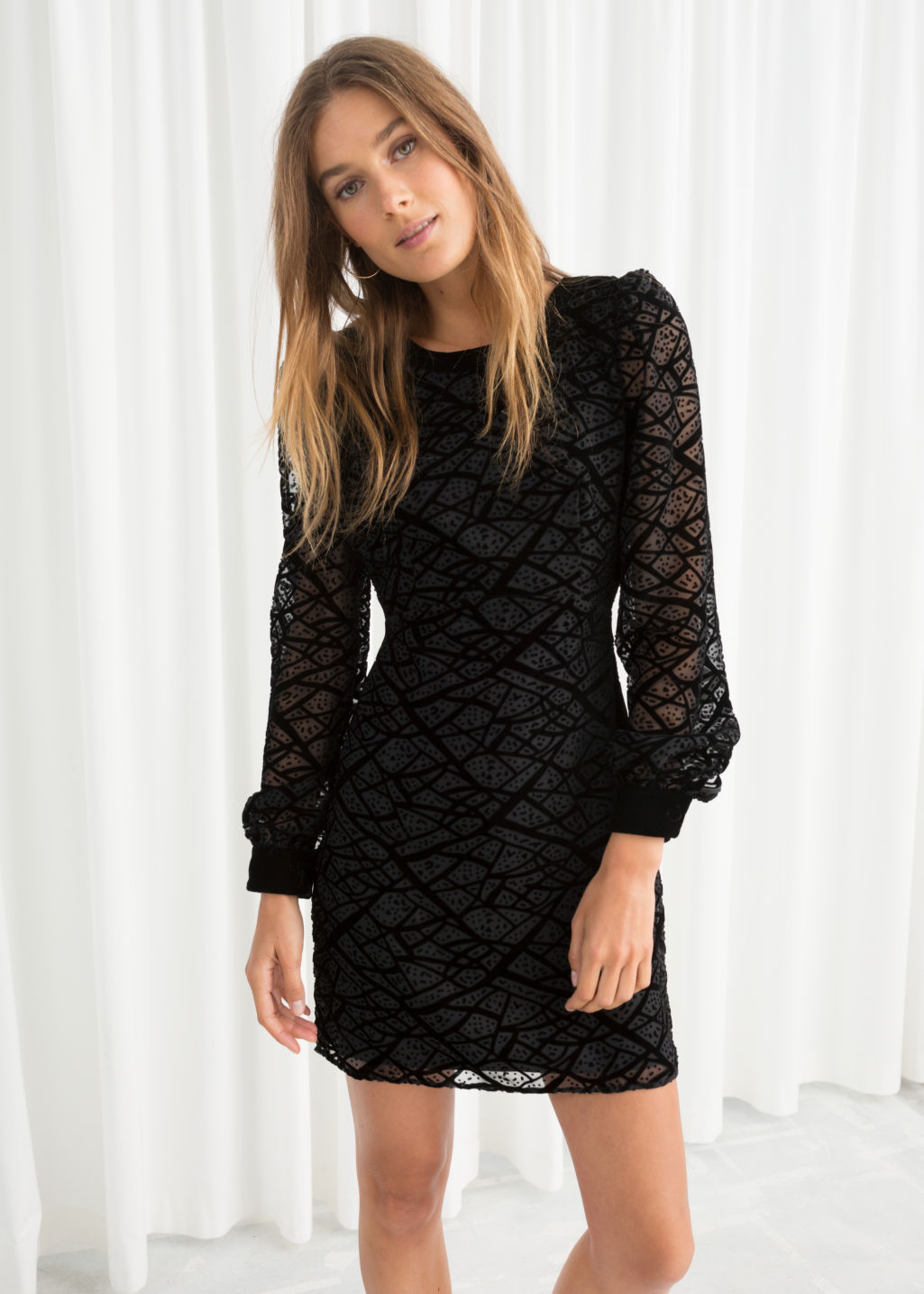 Model front image of Stories velvet mesh mini dress in black