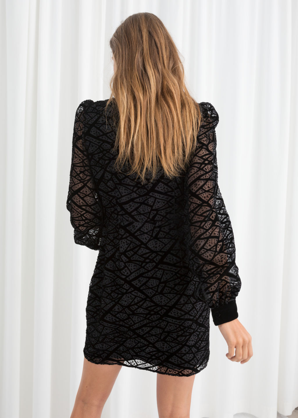 Model back image of Stories velvet mesh mini dress in black