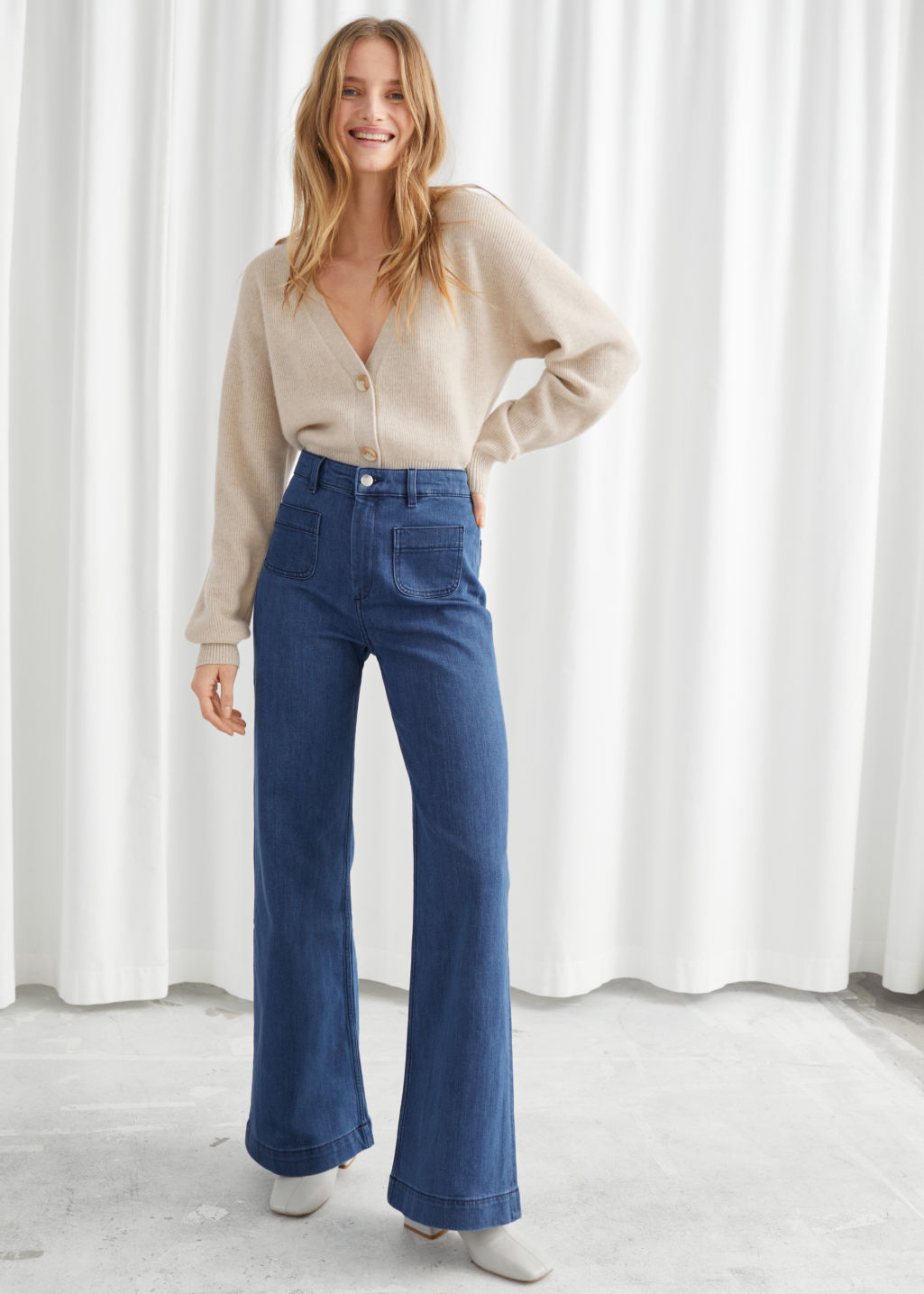 Model front image of Stories flared mid rise jeans in blue