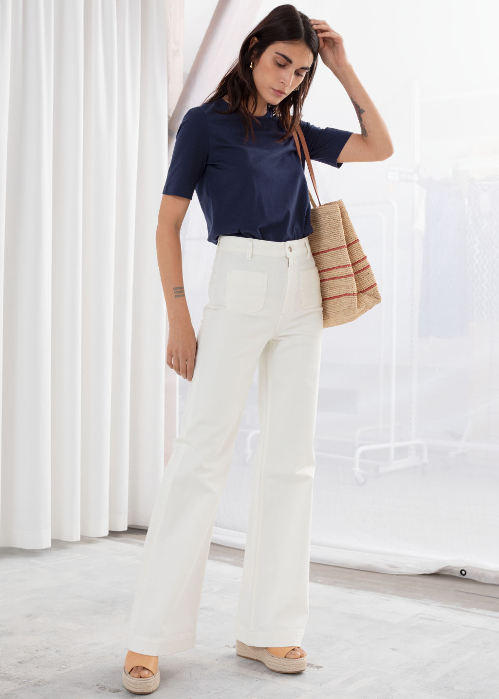 Model front image of Stories flared mid rise jeans in white