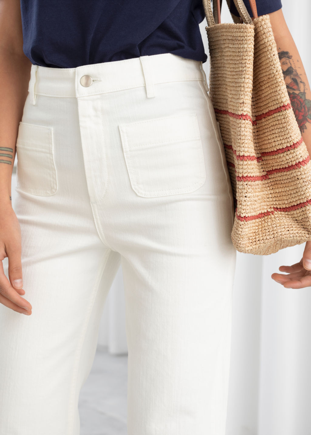 Model back image of Stories flared mid rise jeans in white