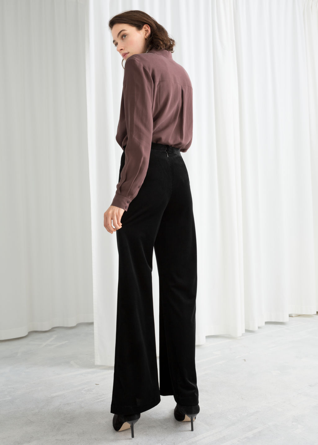 Model back image of Stories flared velour trousers in black