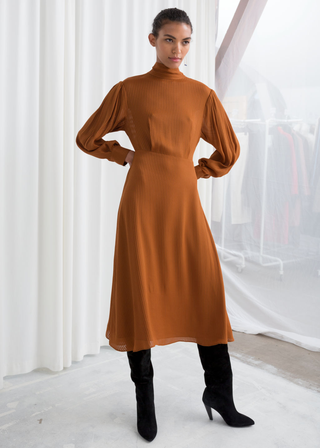 Model front image of Stories sheer stripe midi dress in orange