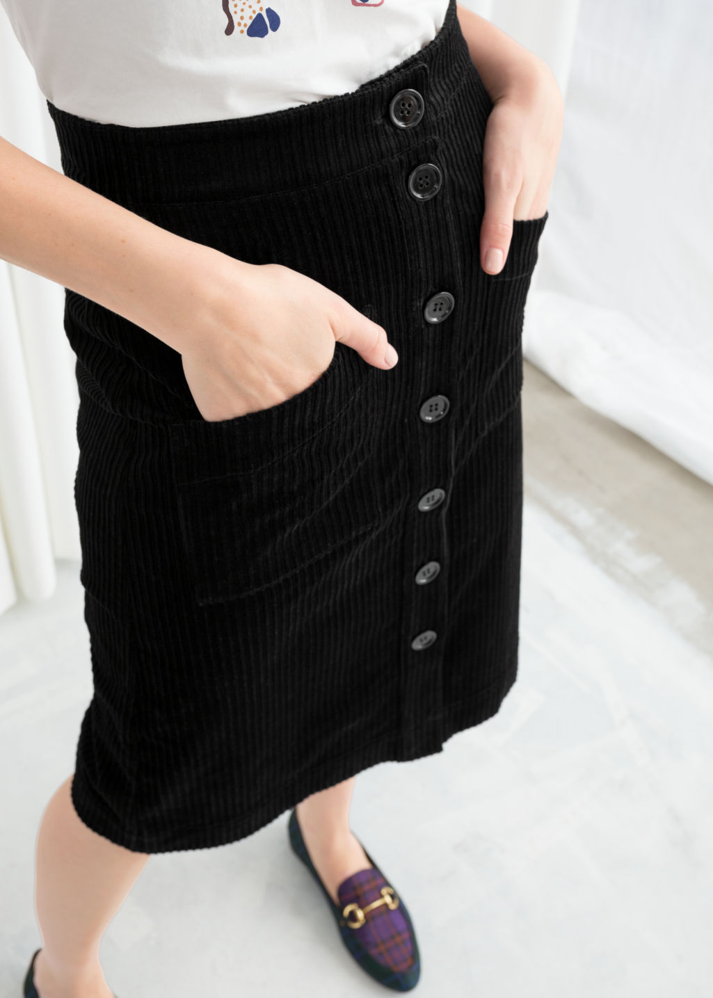 Model back image of Stories a-line corduroy skirt in black