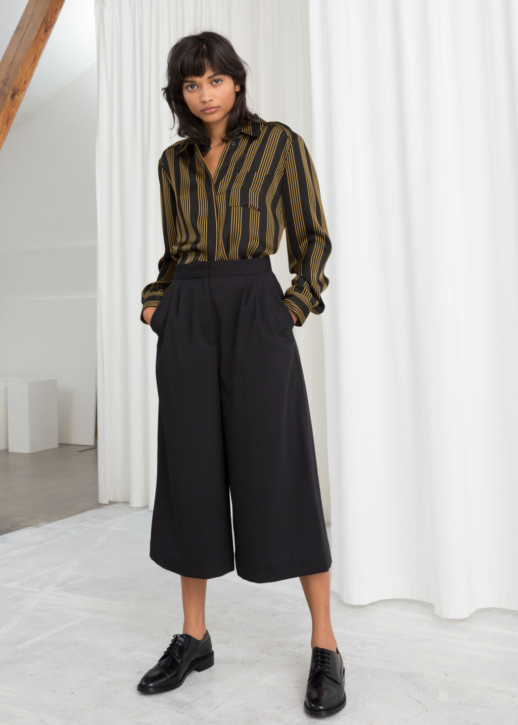 Model front image of Stories high waisted twill culottes in black