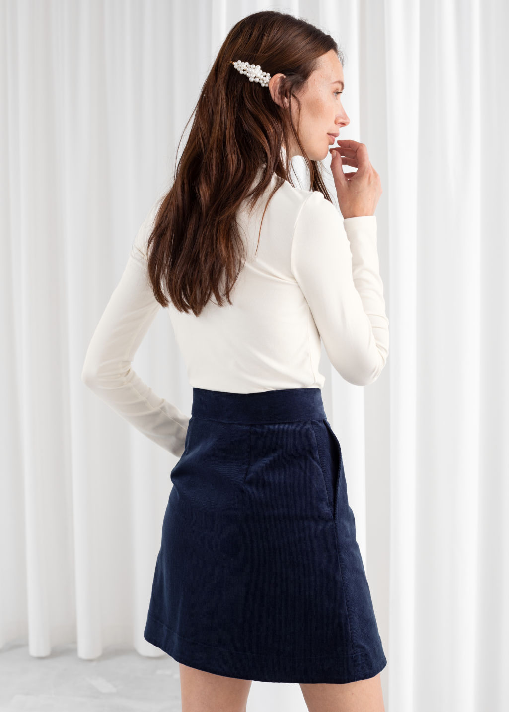 Model back image of Stories corduroy mini skirt in blue