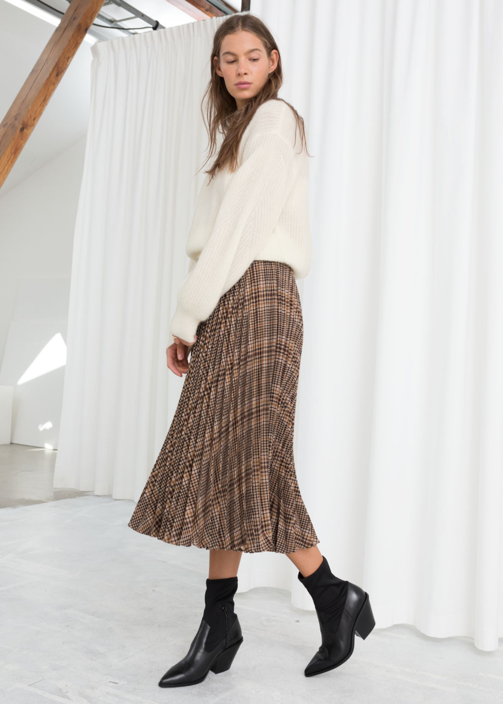 Model front image of Stories pleated plaid midi skirt in brown