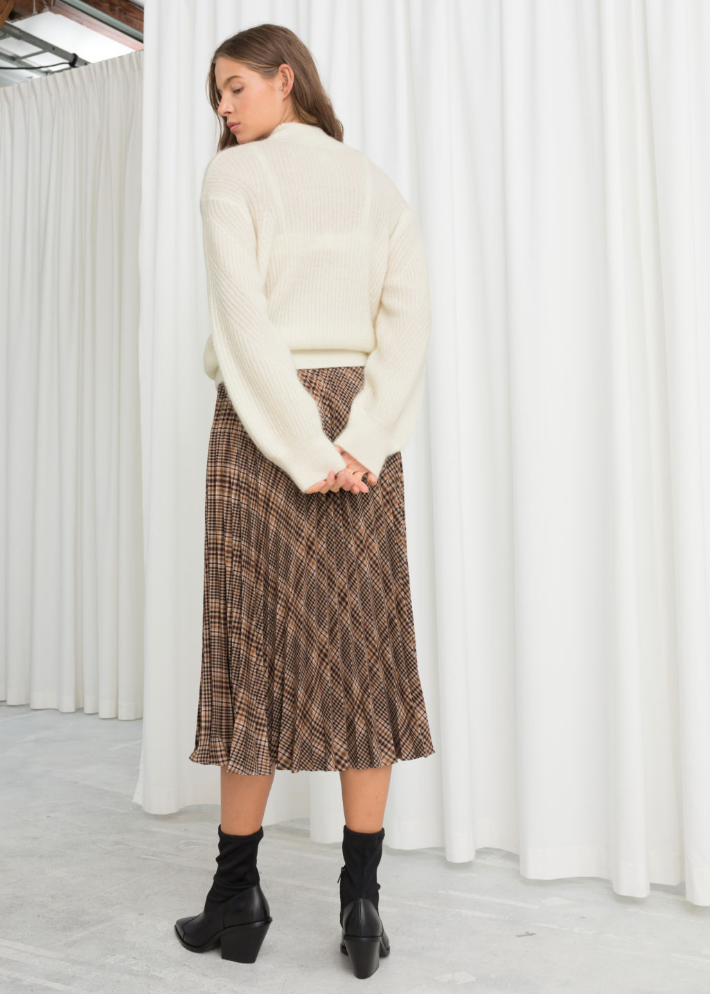 Model back image of Stories pleated plaid midi skirt in brown