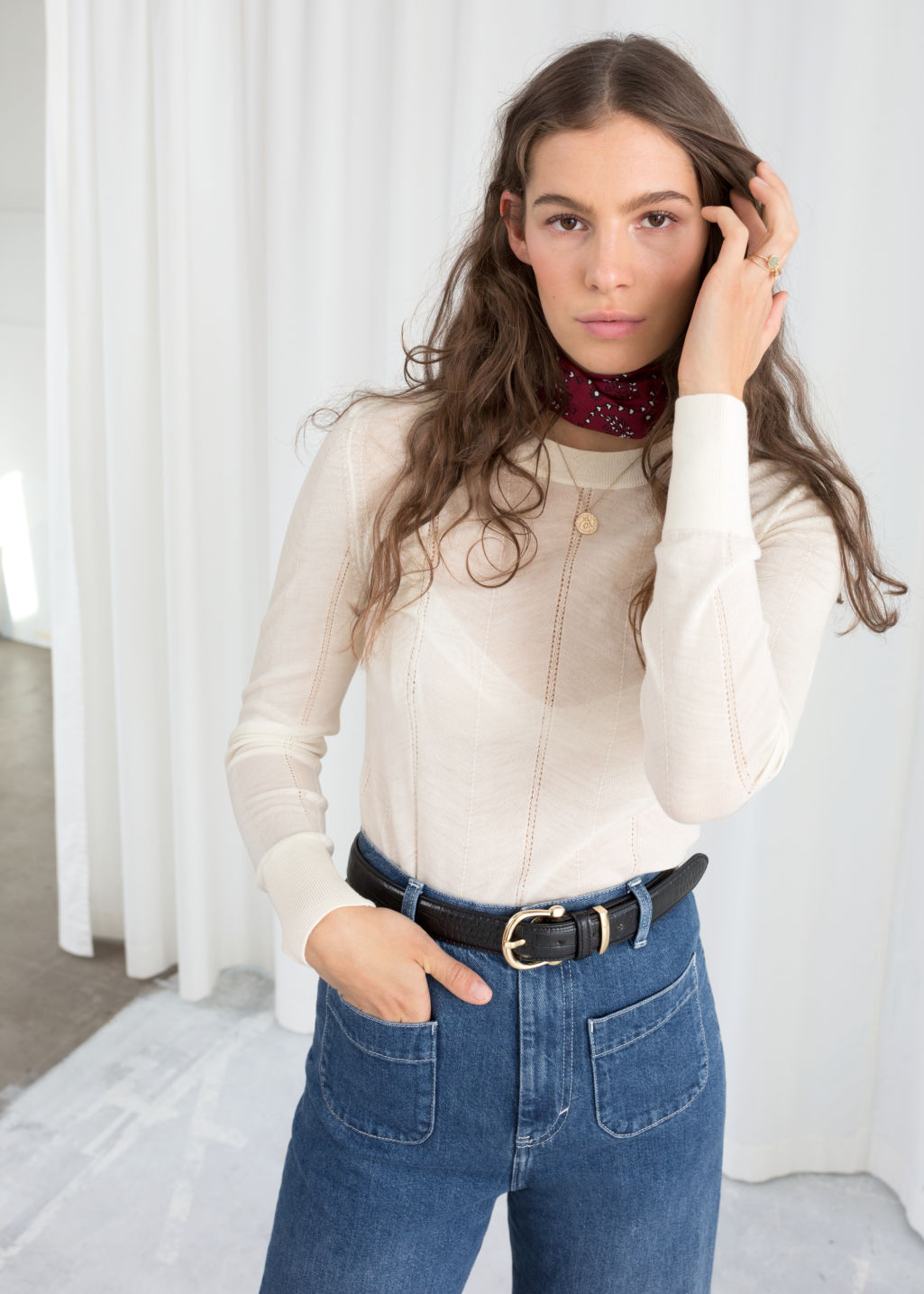 Model front image of Stories merino wool sweater in white