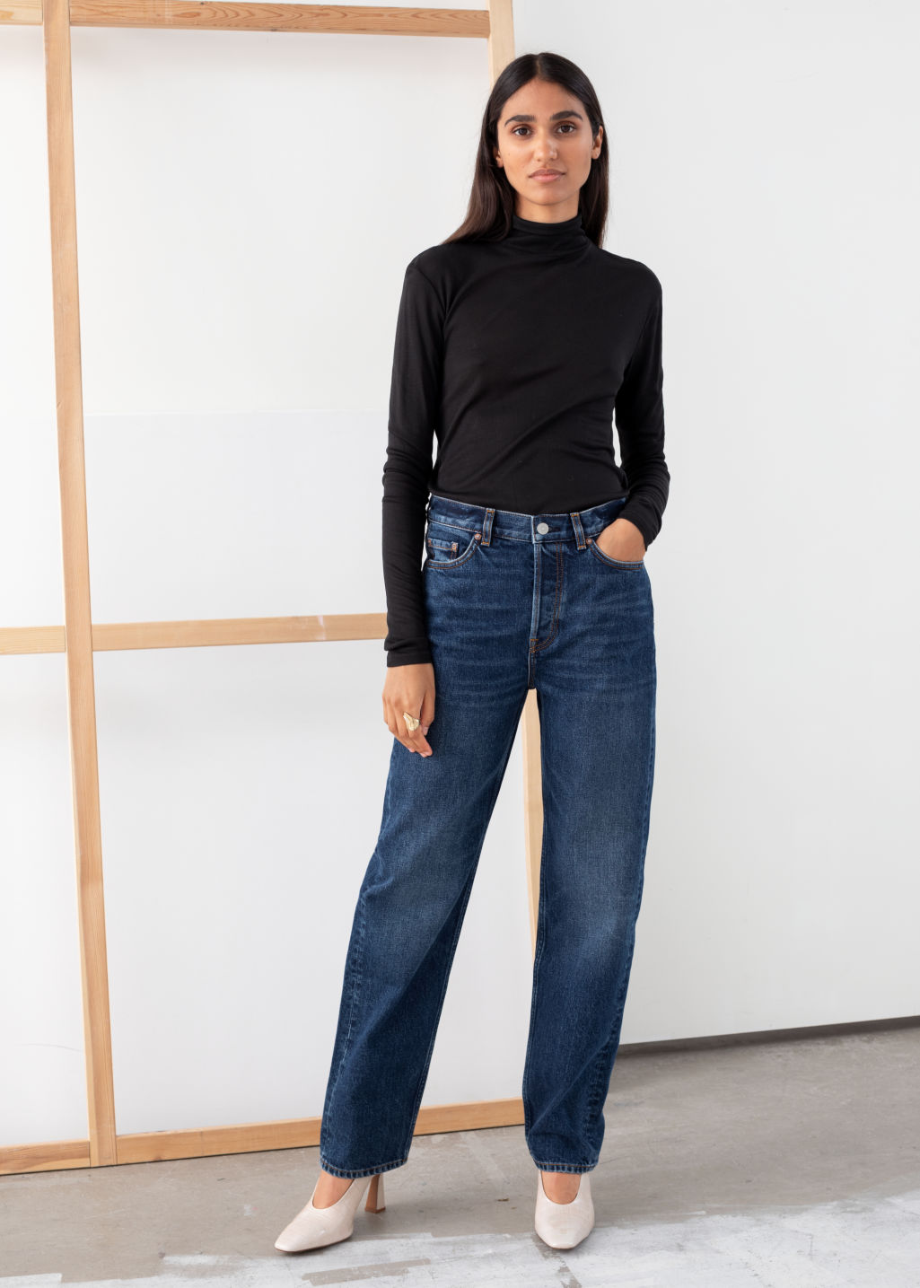 Model front image of Stories straight mid rise jeans in blue