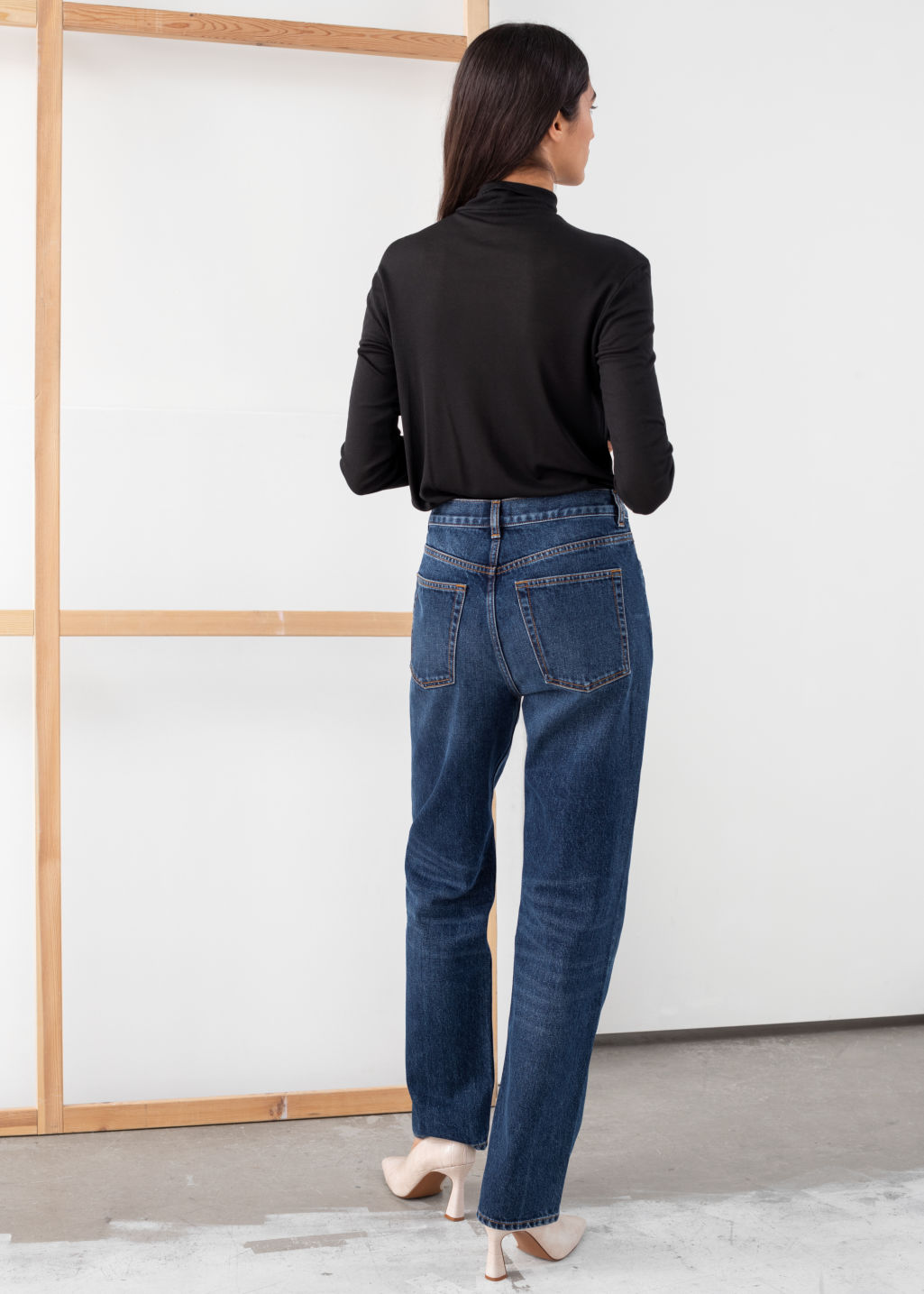 Model back image of Stories straight mid rise jeans in blue