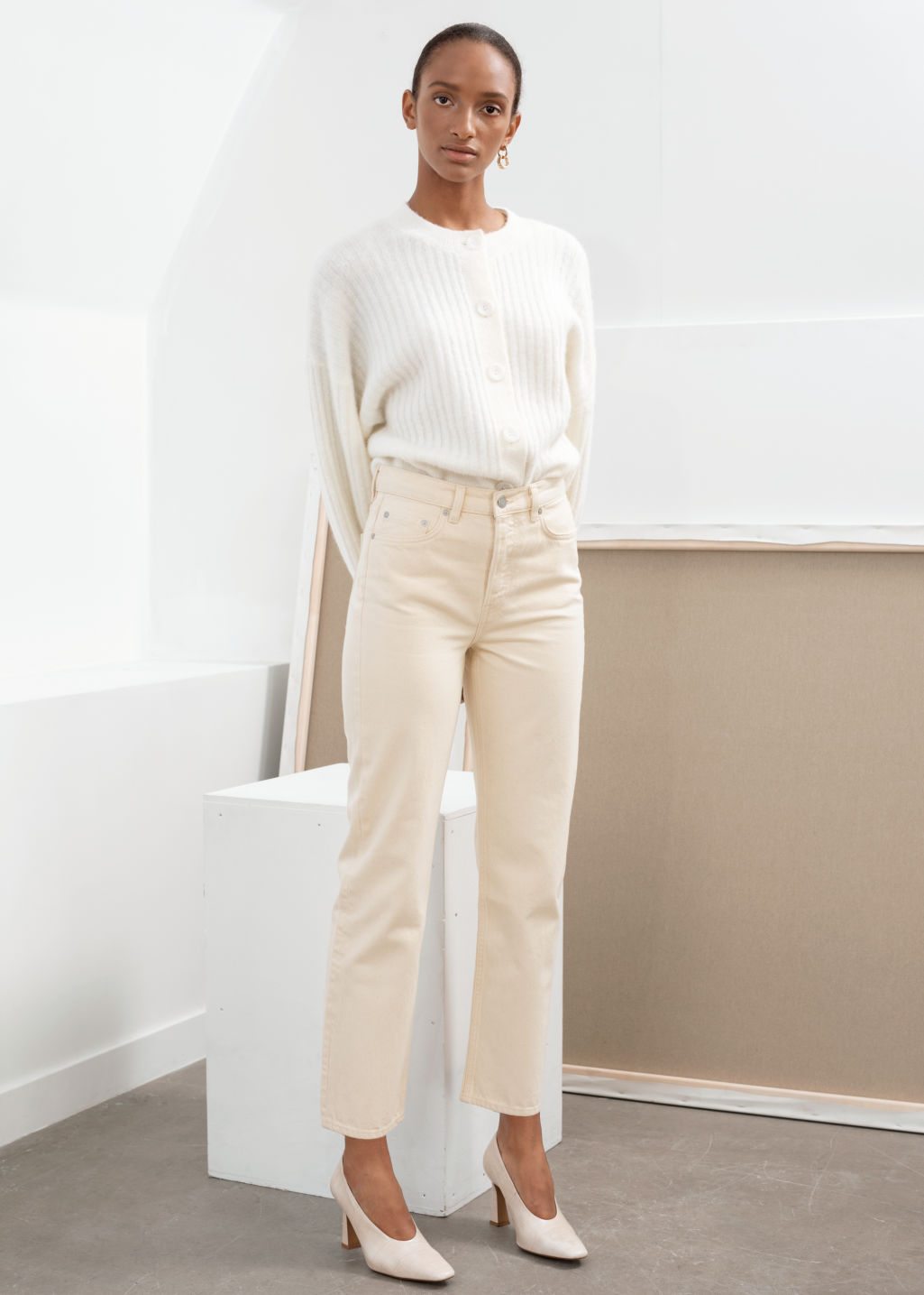 Model front image of Stories straight mid rise jeans in beige