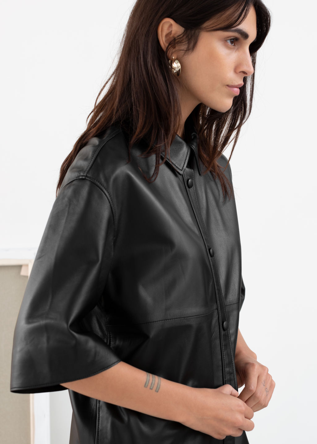 Model back image of Stories leather button down overshirt in black