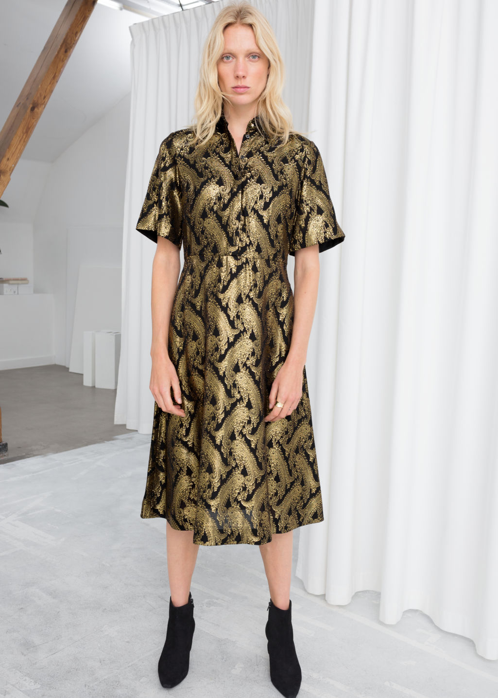 Model front image of Stories metallic jacquard shirt dress in black
