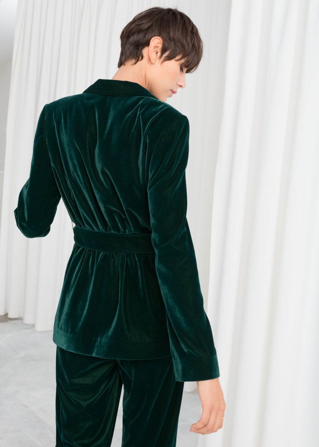 Model back image of Stories velvet belted blazer in turquoise
