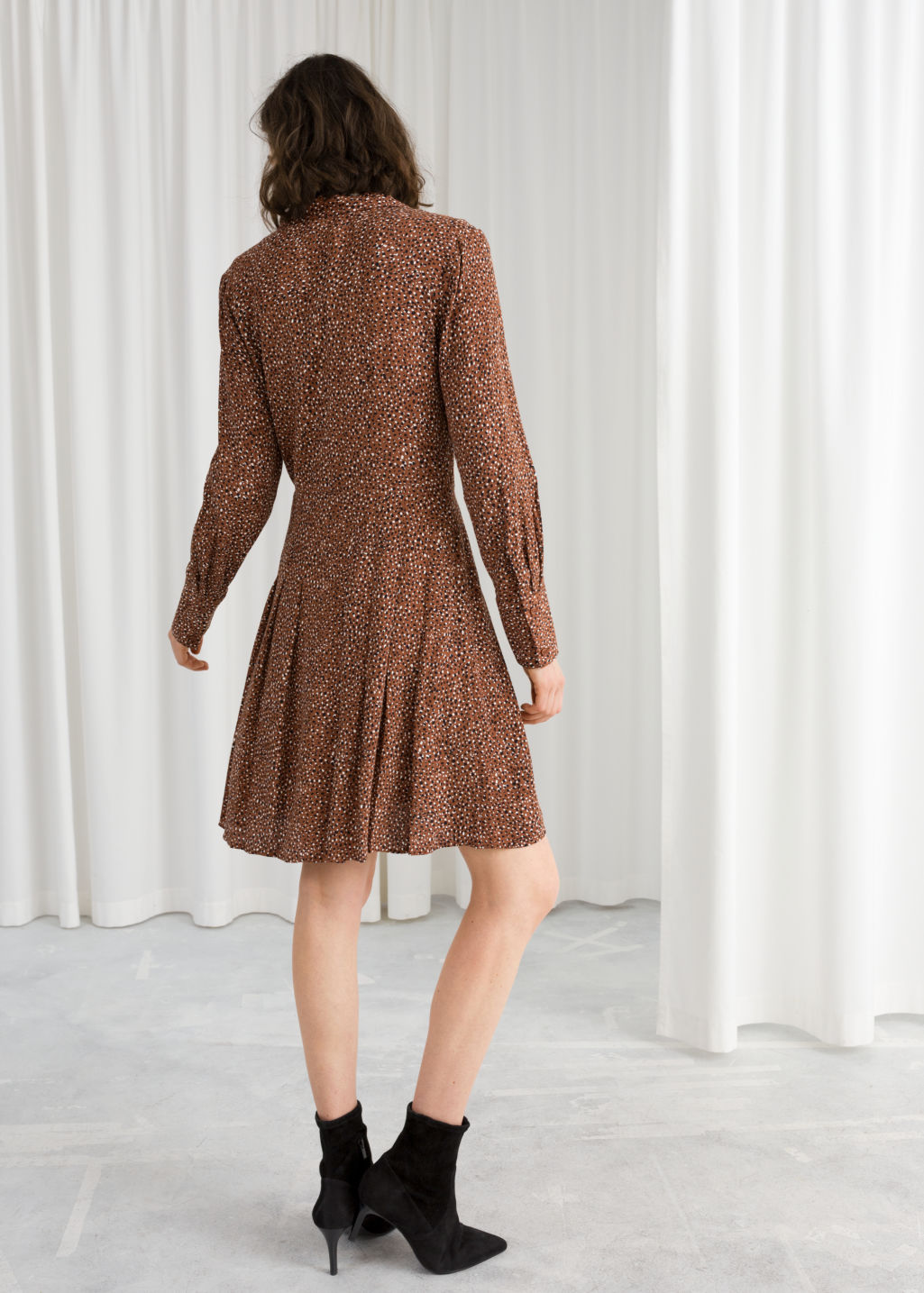 Model back image of Stories animal print pleated dress in beige