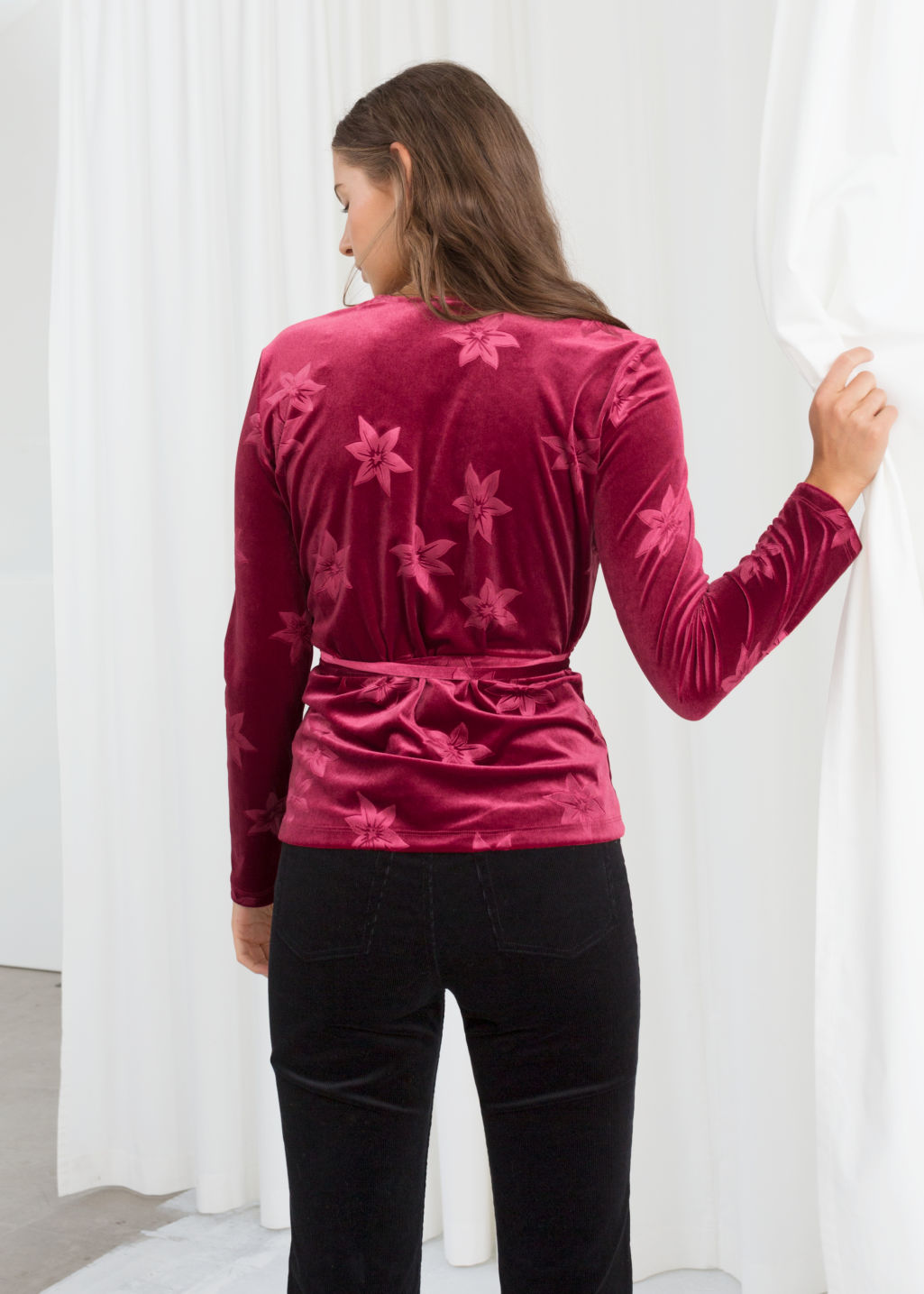 Model back image of Stories floral velvet wrap top in red