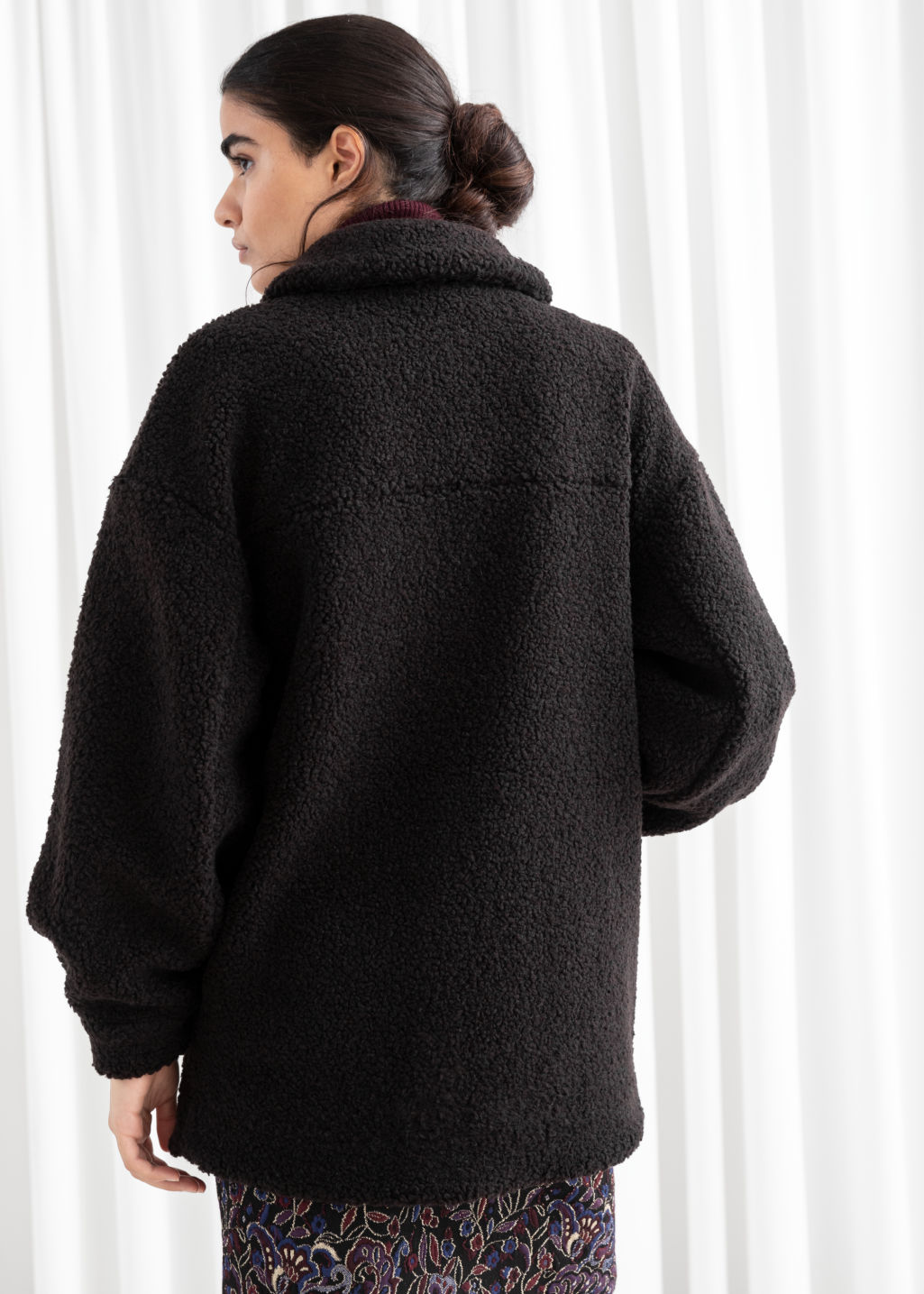 Model back image of Stories  faux shearling workwear jacket in blue