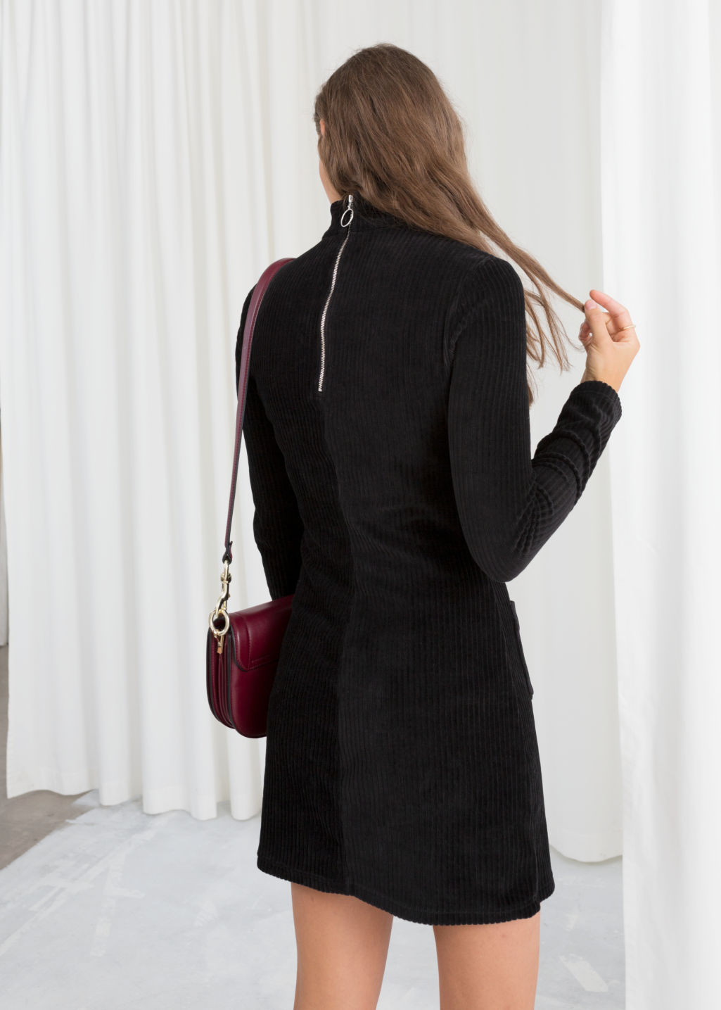 Model back image of Stories turtleneck velour mini dress in black