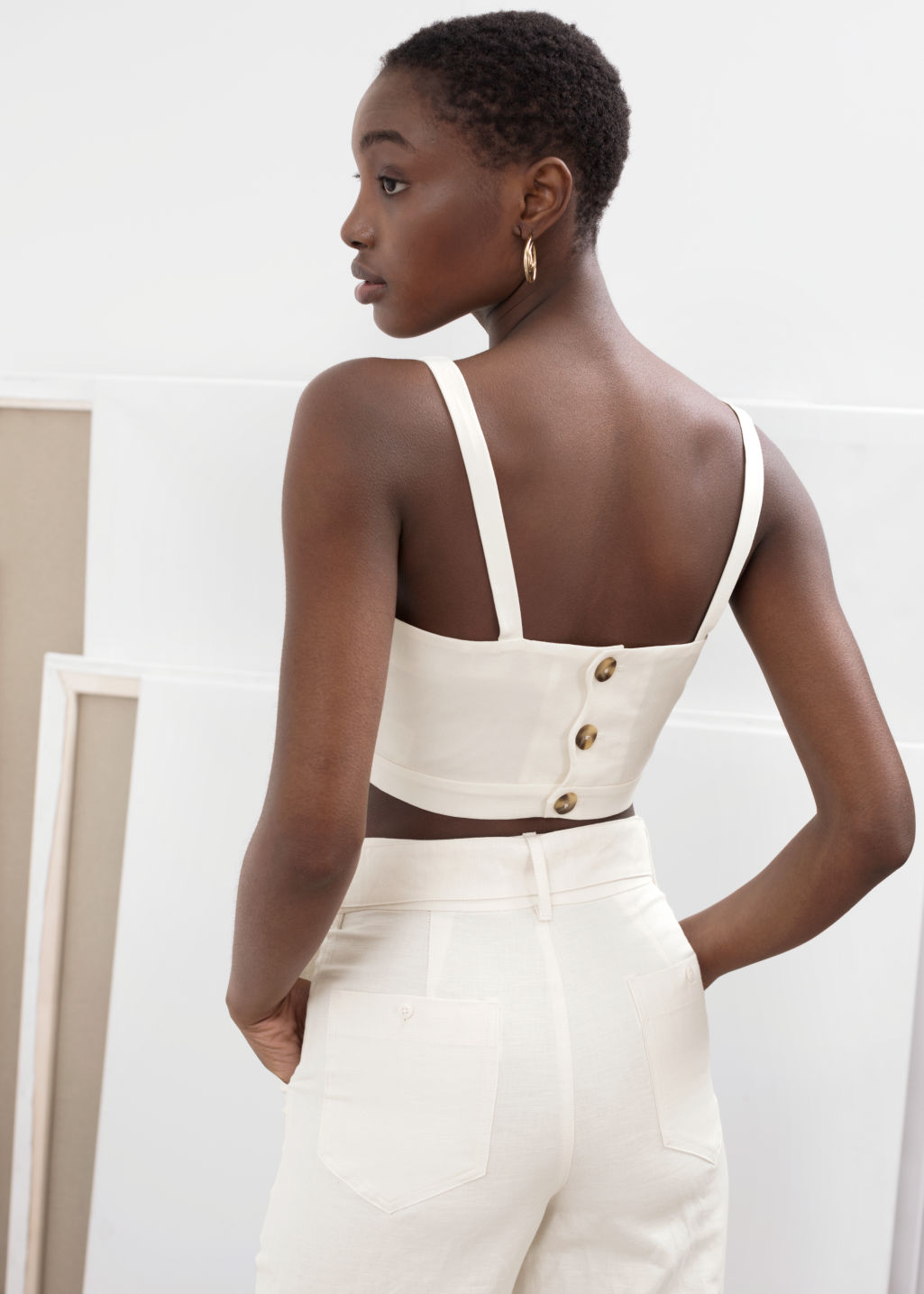 Model back image of Stories square bustier tank top in white