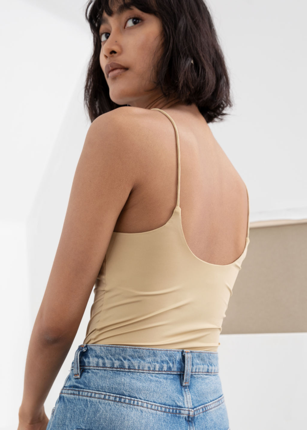Model back image of Stories micro spaghetti strap tank top in beige