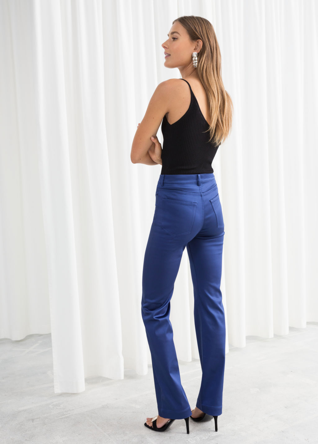 Model back image of Stories high waisted satin trousers in blue