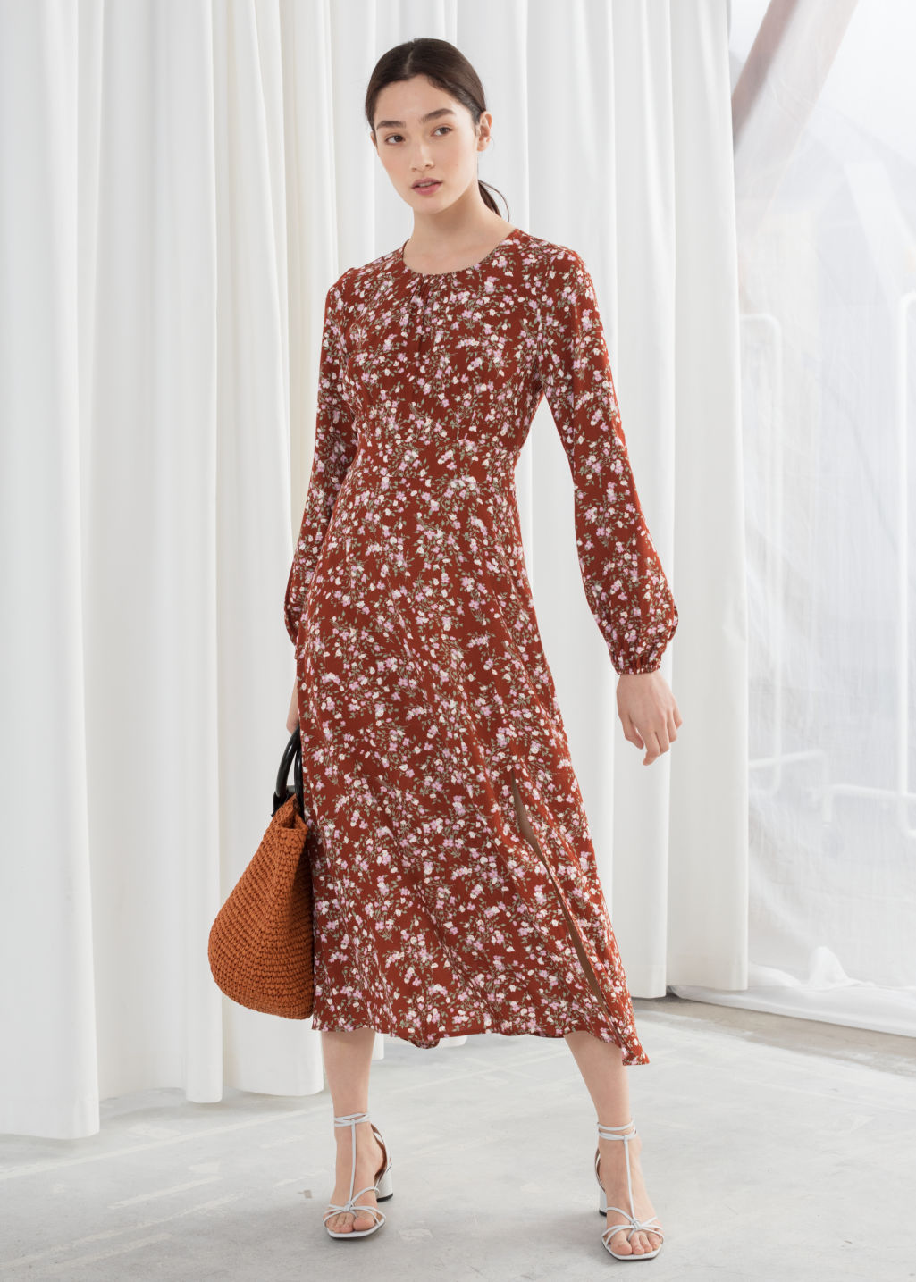 bfdd61cd Model front image of Stories floral long sleeve midi dress in orange
