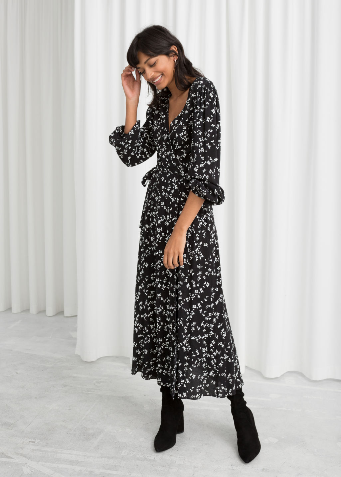 Model Back Image Of Stories Petal Printed Wrap Dress In Black