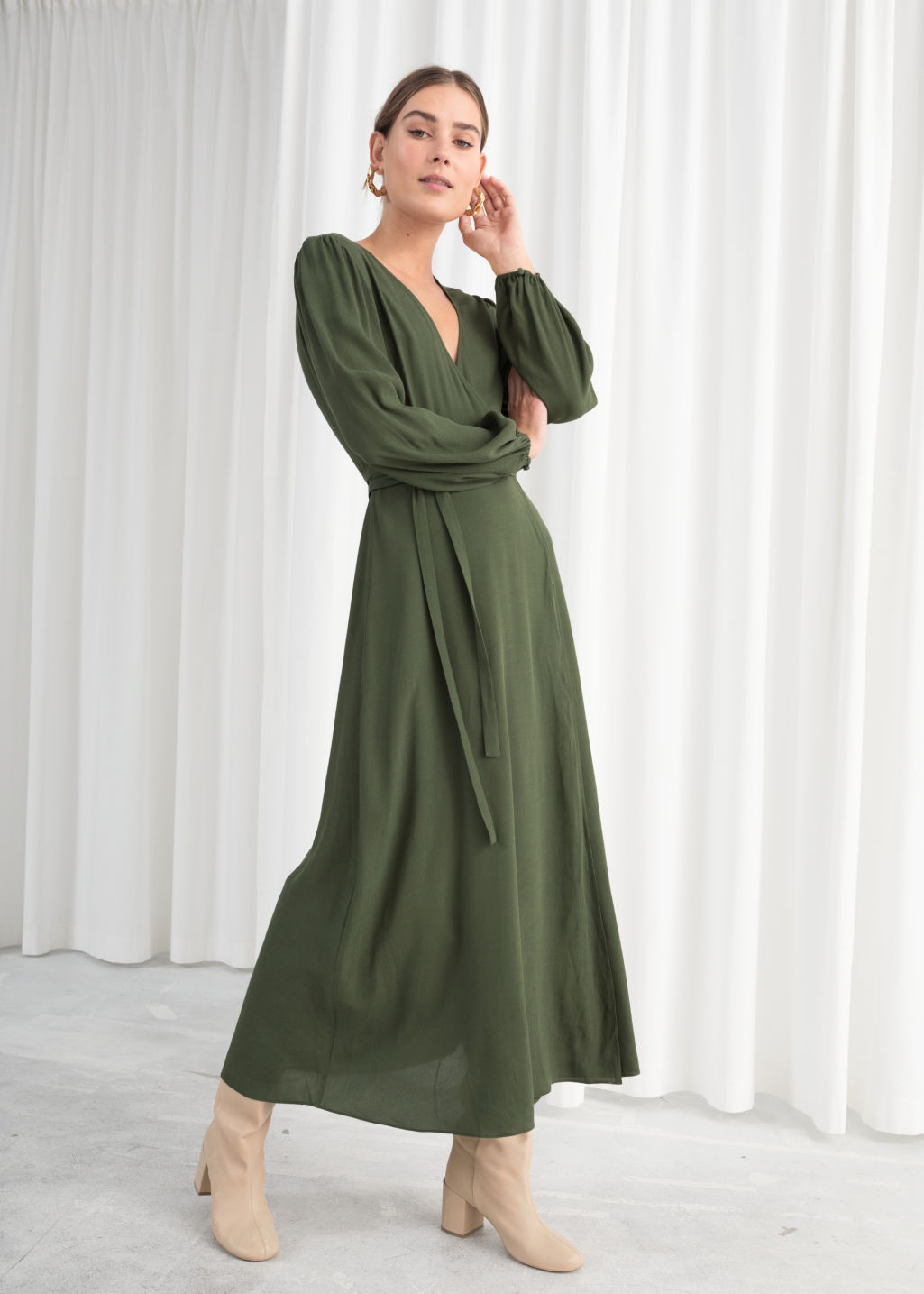 Model front image of Stories printed wrap dress in green