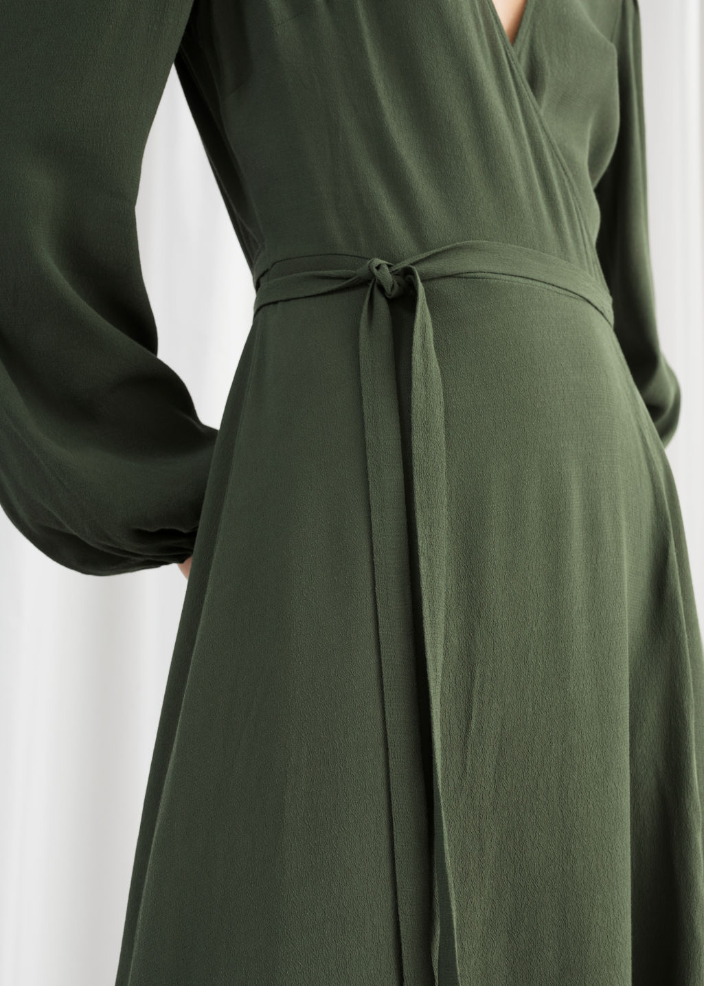 Model back image of Stories printed wrap dress in green