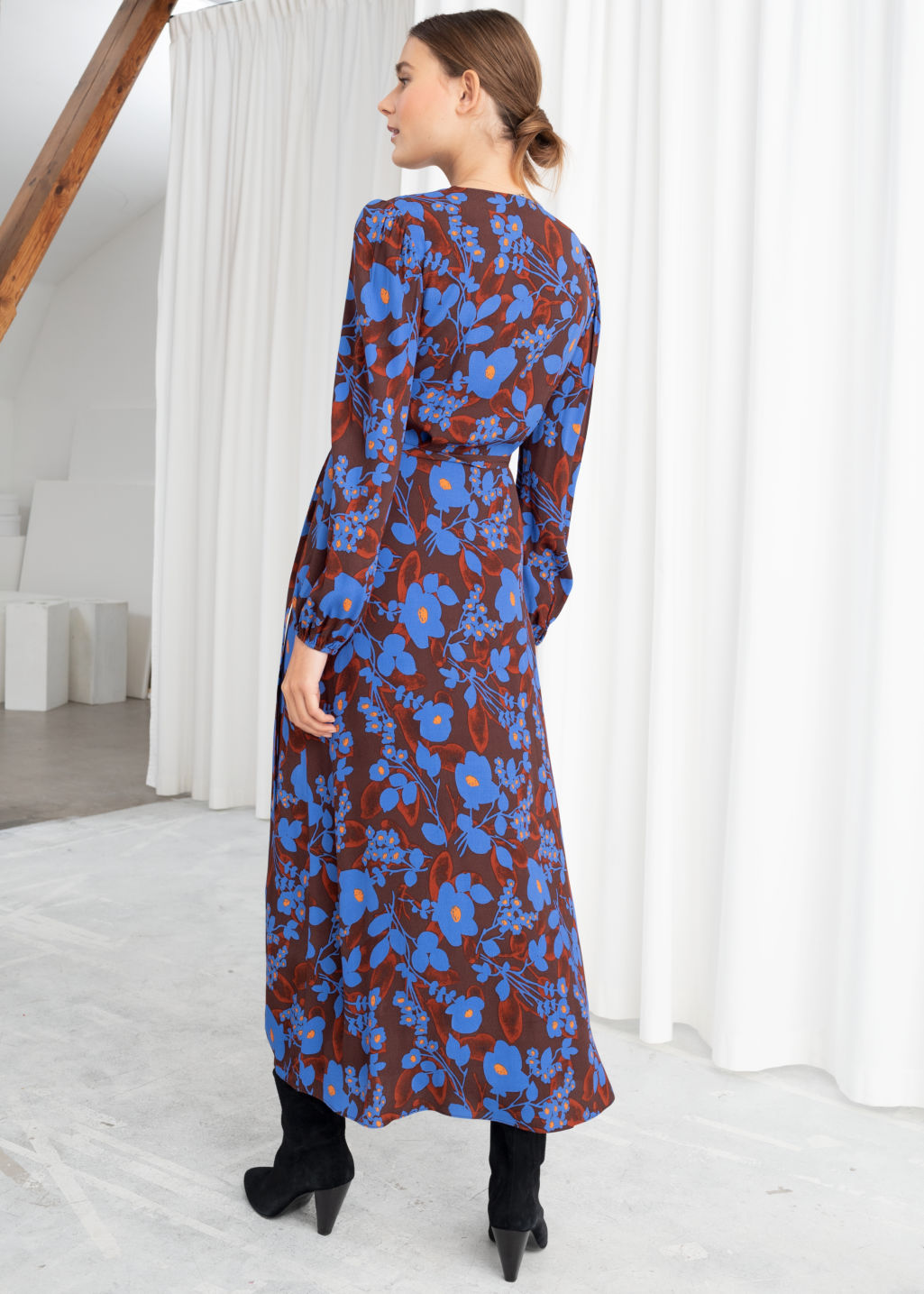 Model front image of Stories printed wrap dress in blue