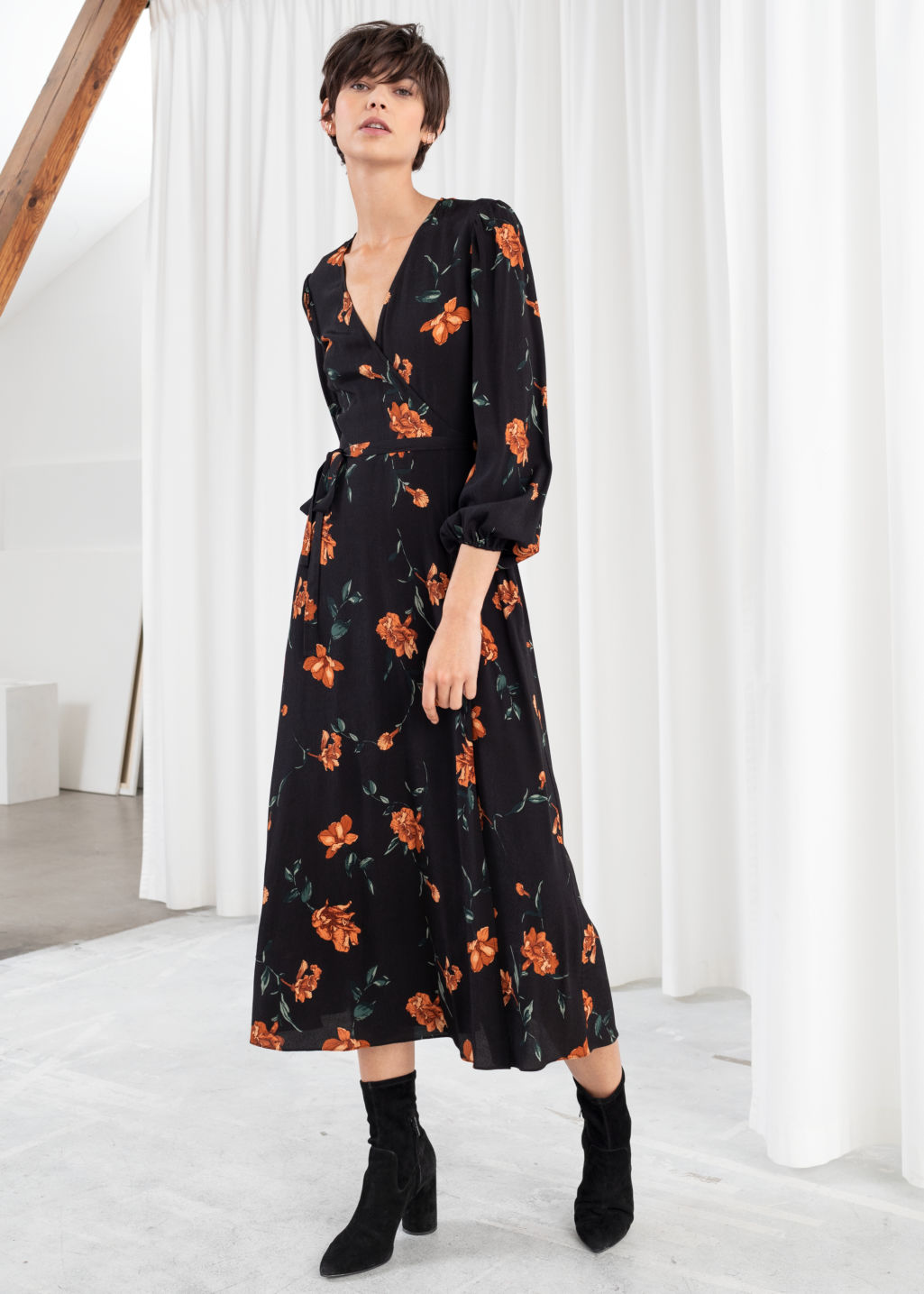 Model front image of Stories wrap midi dress in black