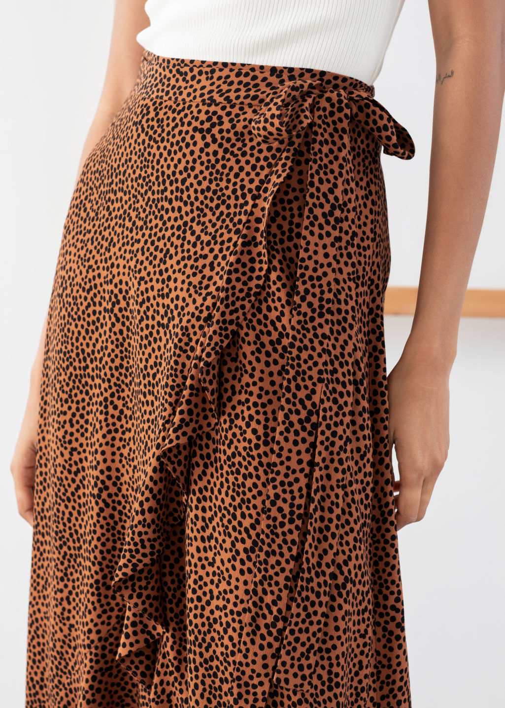 Model back image of Stories ruffle wrap maxi skirt in orange